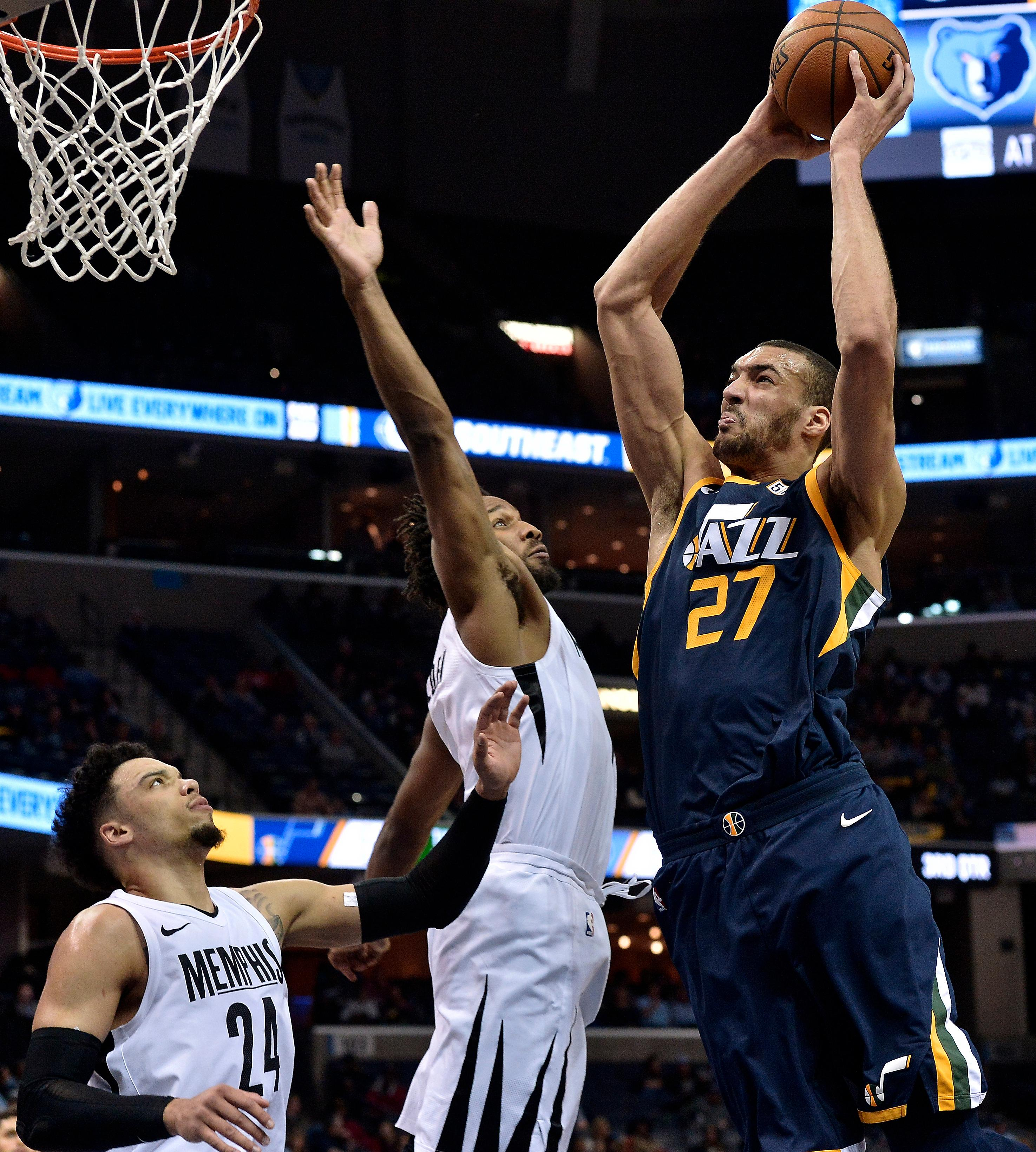Utah Jazz center Rudy Gobert (27) goes up for a dunk against Memphis Grizzlies guard Wayne Selden, center, and forward Dillon Brooks (24) during the second half of an NBA basketball game Wednesday, Feb. 7, 2018, in Memphis, Tenn. (AP Photo/Brandon Dill)