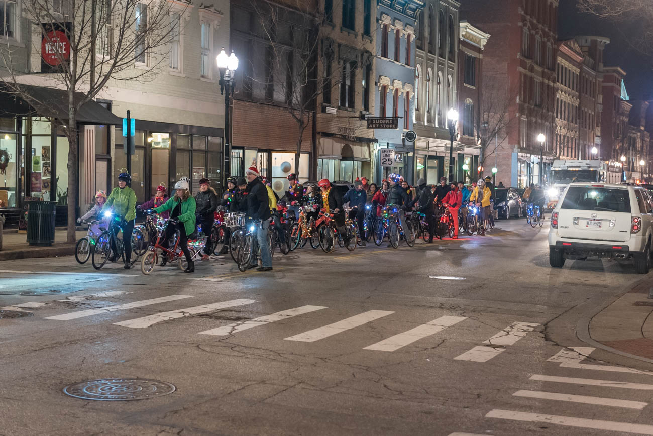 The 2018 Holiday BRIGHT Ride was held in Downtown and OTR on Saturday, December 22. Participants dressed up their bikes with lights and reflective objects and met in Washington Park before riding through the city. The 2.7 mile route traveled through sections of Over-the-Rhine and Downtown before looping back to Washington Park where it began. The event is held annually to enliven the streets with a little visual flair around the holidays. / Image: Mike Menke // Published: 12.23.18