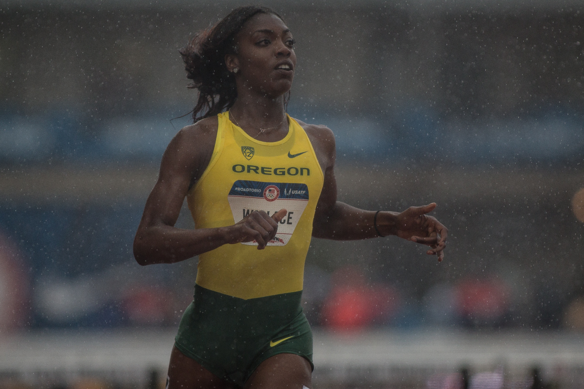 Sasha Wallace of Oregon finishes the 100m hurdles in the pouring rain in a time of 13.40. Photo by Dillon Vibes