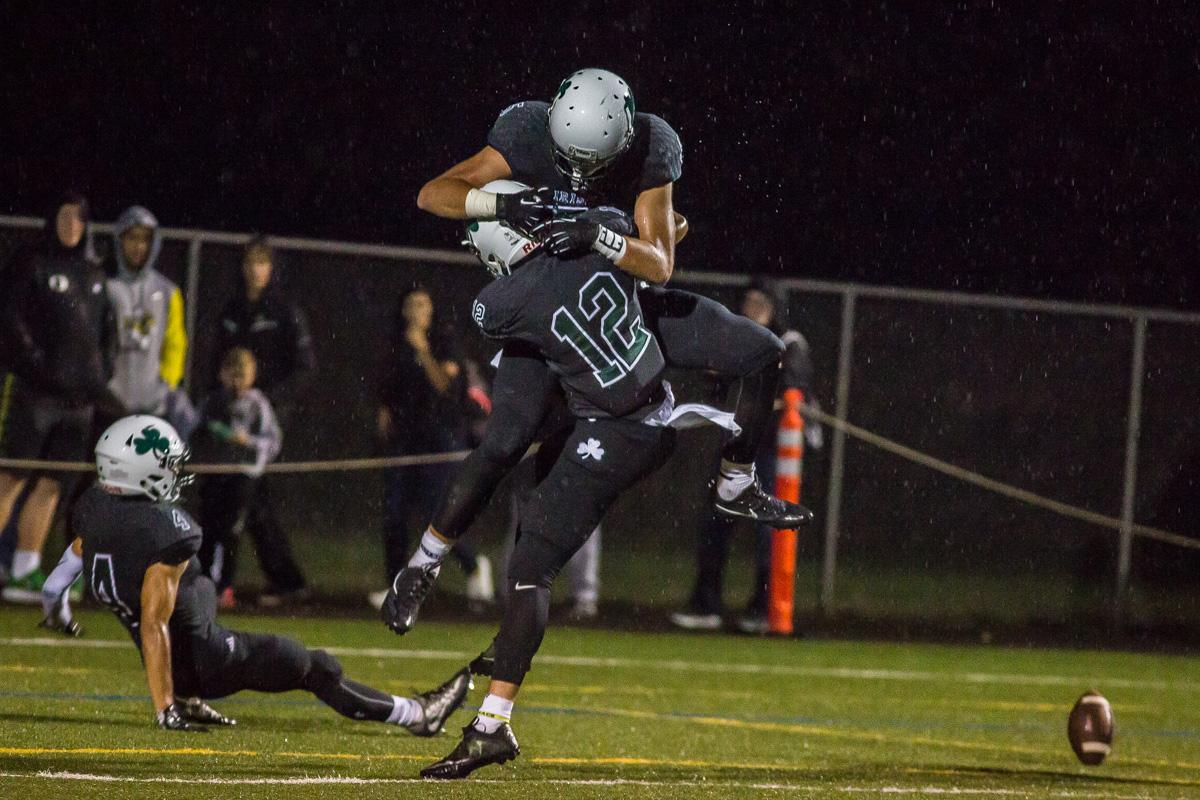 Sheldon receivers Uta Mageo (#12) and Patrick Herbert (#5) celebrate after Herbert's touchdown. On a rainy Monday evening Sheldon defeated West Salem 41-7 at home. The game had been postponed from Friday due to unhealthy levels of smoke in the atmosphere due to nearby forest fires. Photo by Dillon Vibes