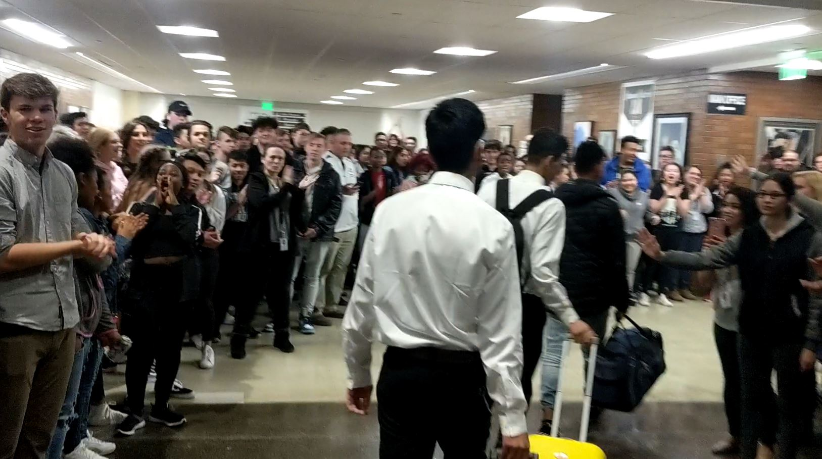 The Cottonwood High School Robotics Club, comprised mostly of refugee students representing multiple countries, got a celebrity sendoff from their classmates on Tuesday. (Photo: Robyn Ivins)
