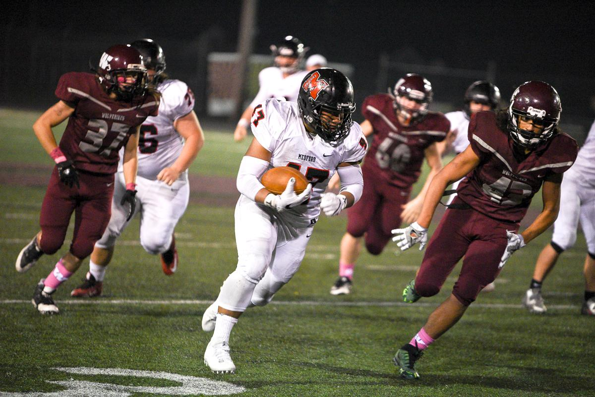 North Medford running back Isaac Manuel (#47) racks up major yards during North Medford's 45-19 victory over Willamette High School. Photo by Jeff Dean, Oregon News Lab