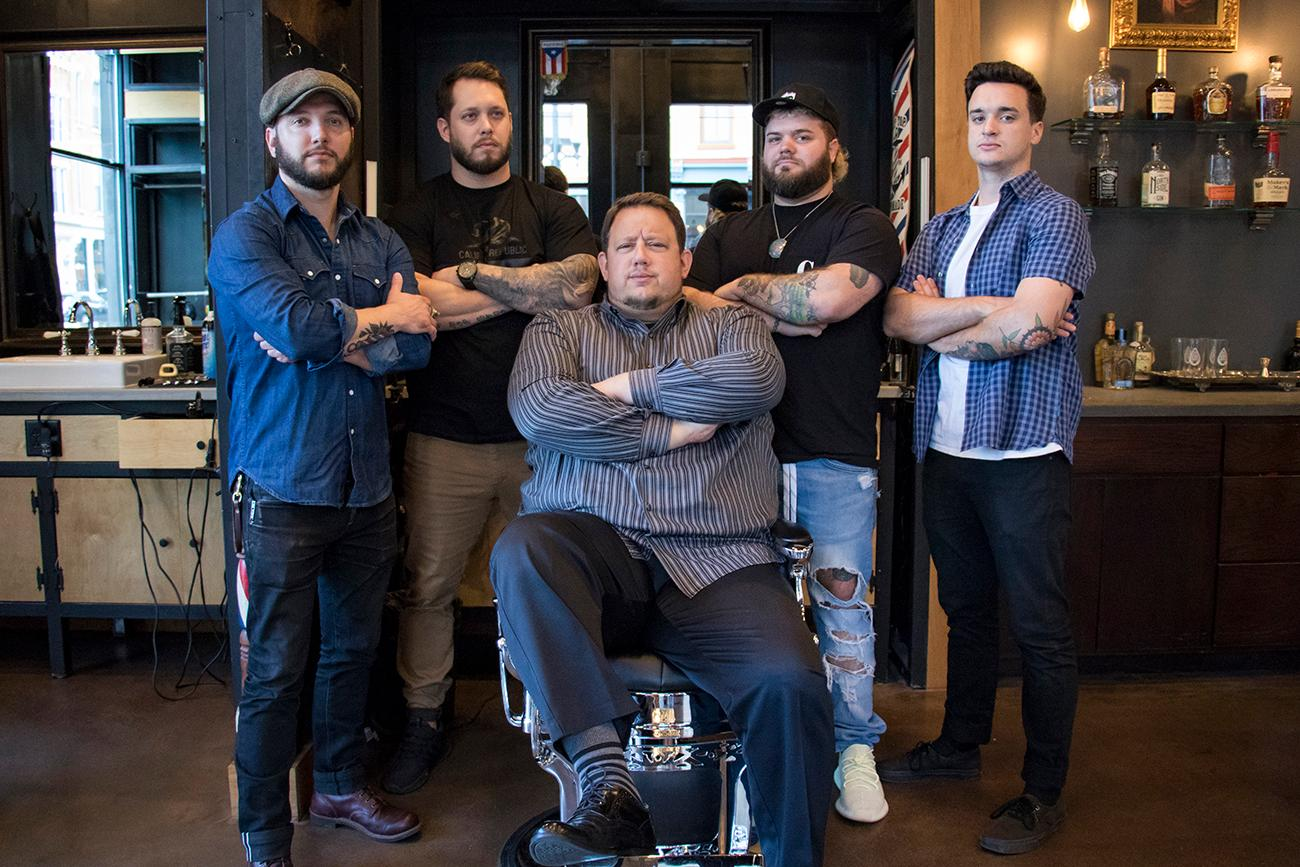 Guido Salzano, owner (pictured center) with his barbers Aaron Mucha, Mark Doyle, Craigen Cavender, Sam Souders, and Felix Sepulveda (not pictured) / Image: Allison McAdams // Published: 9.27.18
