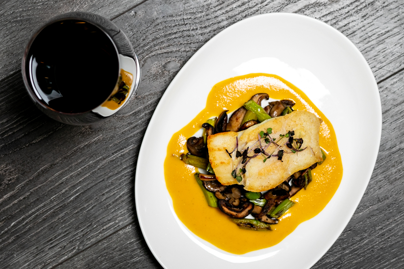 Atlantic halibut served with asparagus, mushroom, and an orange corn reduction{ }/ Image: Amy Elisabeth Spasoff // Published: 11.28.18