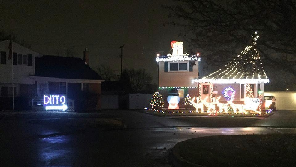 a sign that spells ditto is on display next door to a home with christmas lights on display on dec 12 2016 in westland mich