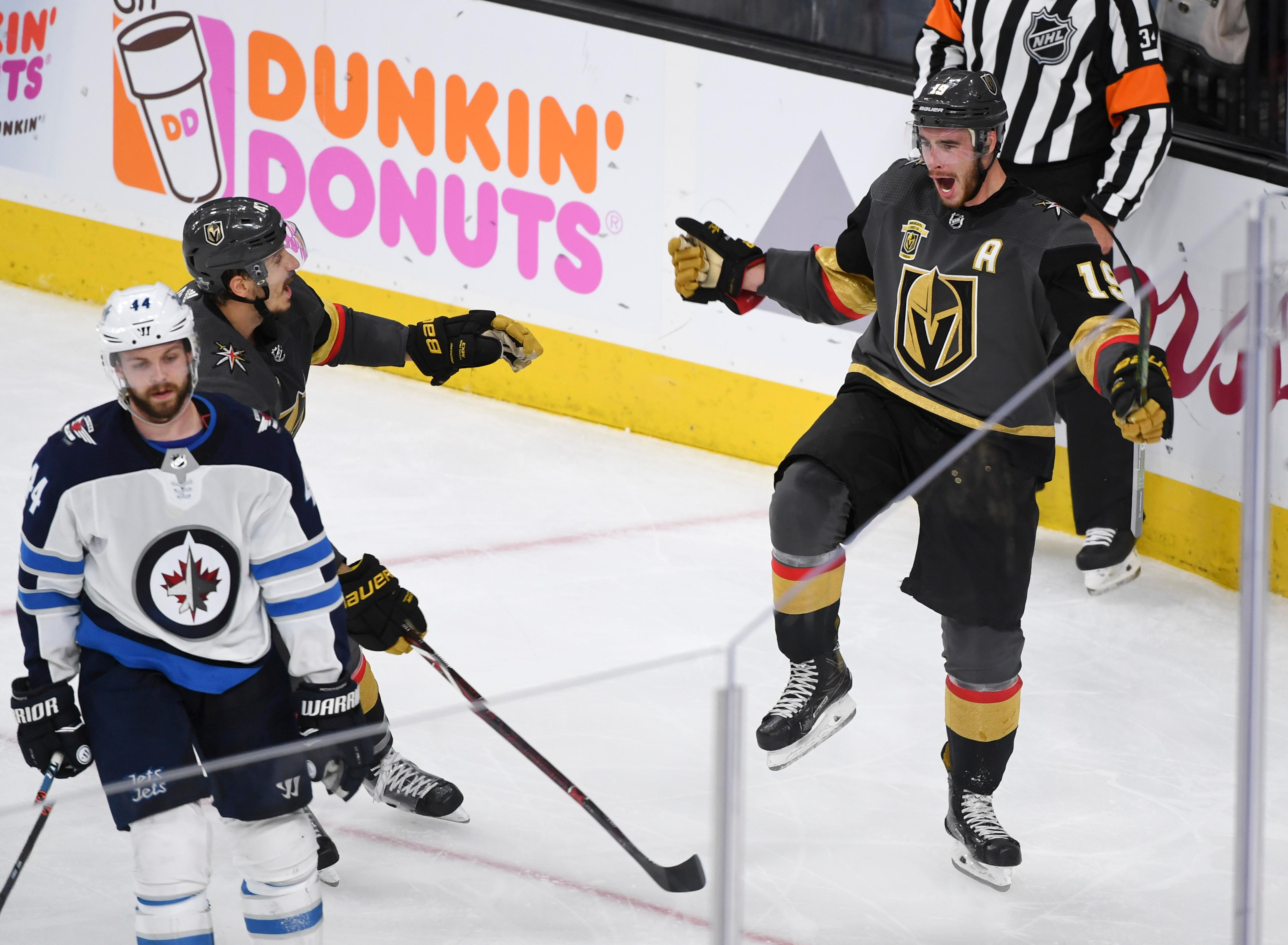 Vegas Golden Knights defenseman Luca Sbisa (47) and Vegas Golden Knights right wing Reilly Smith (19) celebrate Smith's game-winning goal against the Winnipeg Jets  during Game 4 of their NHL hockey Western Conference Final game Friday, May 18, 2018, at T-Mobile Arena. The Golden Knights won 3-2. CREDIT: Sam Morris/Las Vegas News Bureau