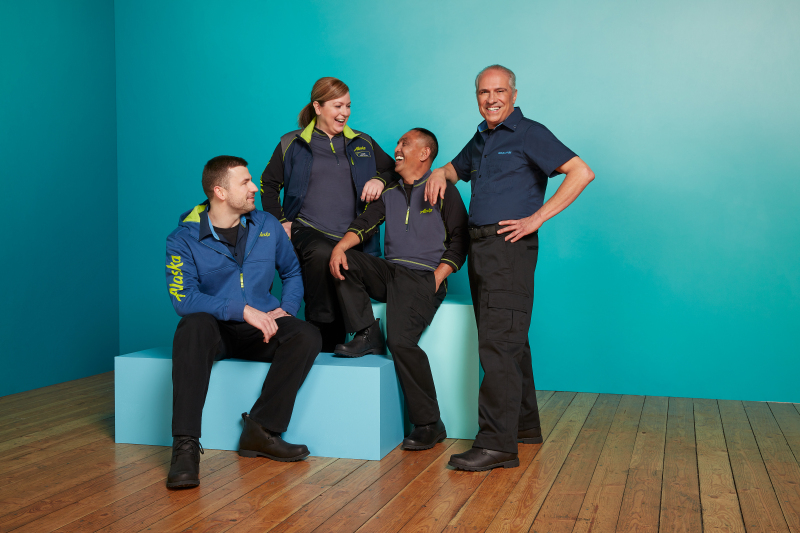 Alaska ground and maintenance workers show off the new uniform collection featuring several layered mix-and-match pieces making it flexible for employees who work in different climates and work environments. (Photo: Alaska Airlines)