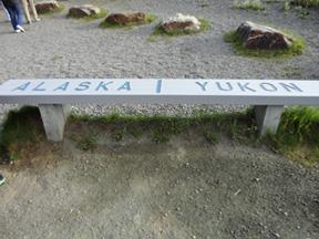 The line that separates Alaska from the Yukon Territory, Canada is in the middle of this bench