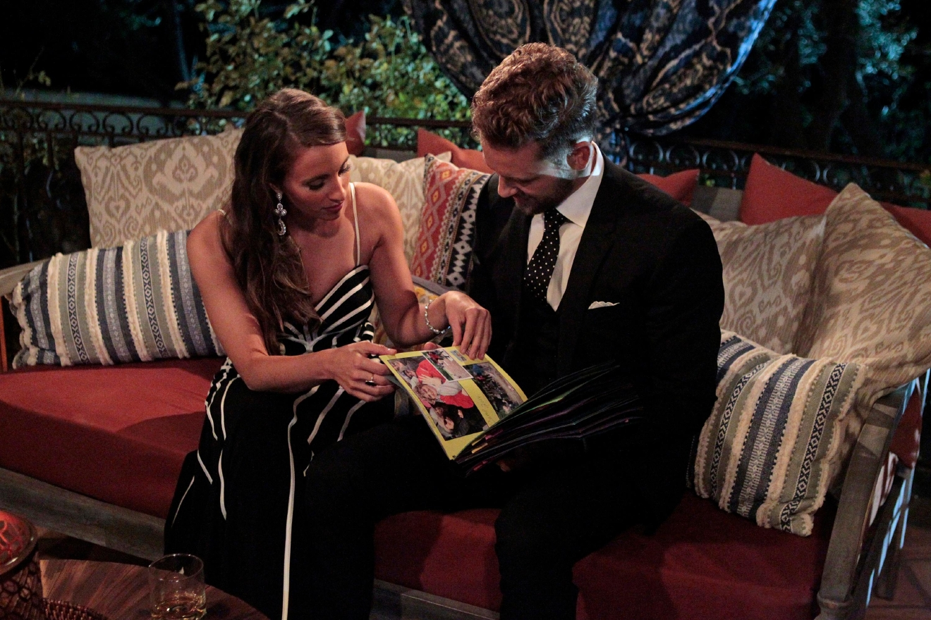 First of all, that dress... still obsessed! But  more importantly, it was obvious that Nick and Vanessa had chemistry from the moment that she stepped out of the limo, and he did a look back at her as she walked into the house. Later in the evening, they share one of the cutest moments of the night as she shows him the scrapbook that her students made as a present to Nick. We find ourselves hoping he'll call the whole thing off and ride off into the sunset with Vanessa right now! Alas, he does not, but she does receive the first rose of the first rose ceremony! (ABC/Rick Rowell)