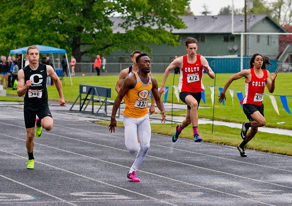 Anthony Gray from Eagle Point wins the 100 meter dash with a time of 11.17 at the 5A-3 Midwestern League District Track Meet. Photo by Dan Morrison, Oregon News Lab