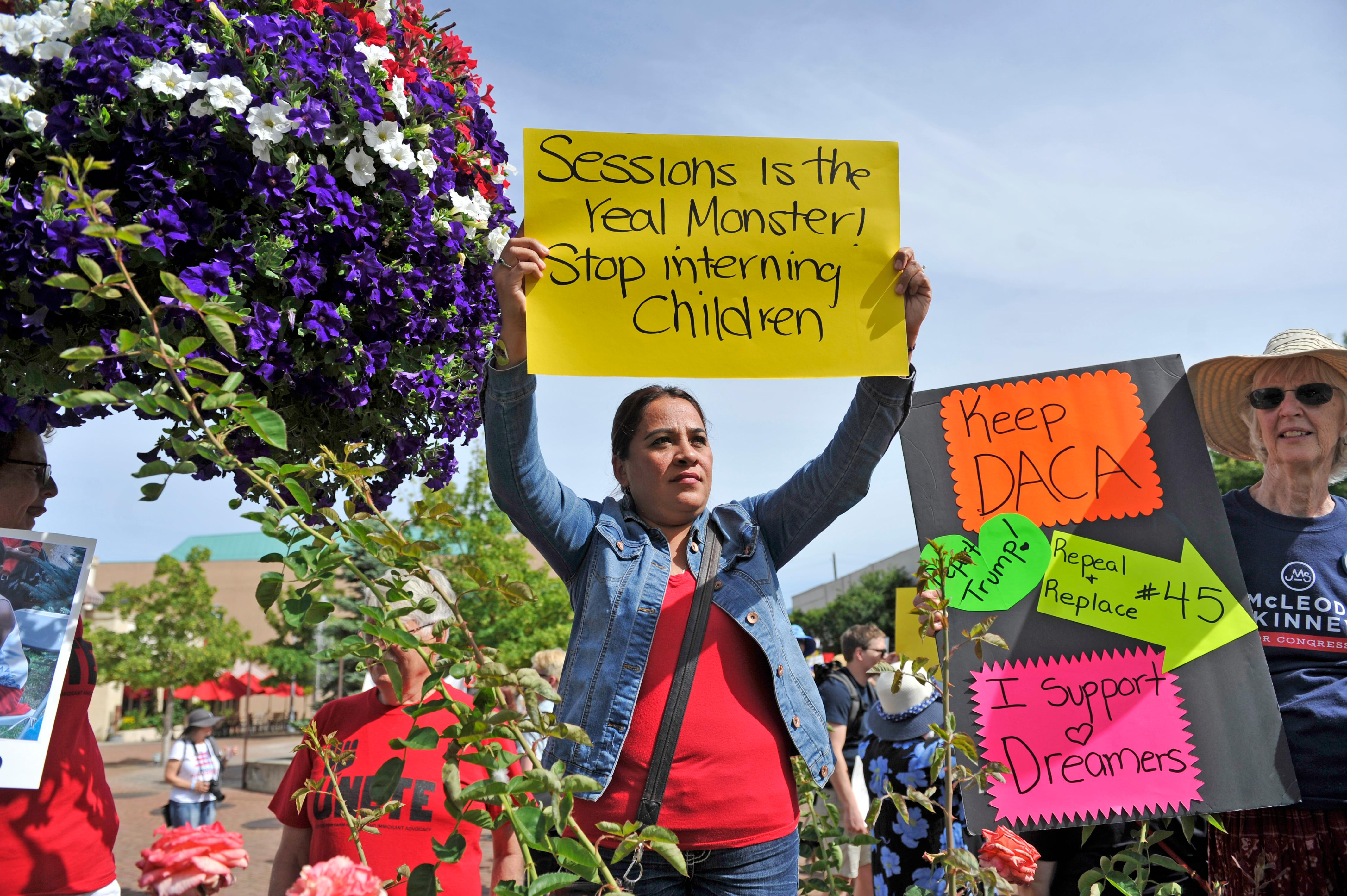 "Jamie Lusch / Mail Tribune{ } Gladis Garcia participates in the ""Where are the Children Rally"" at Vogule Plaza in Medford on Friday."
