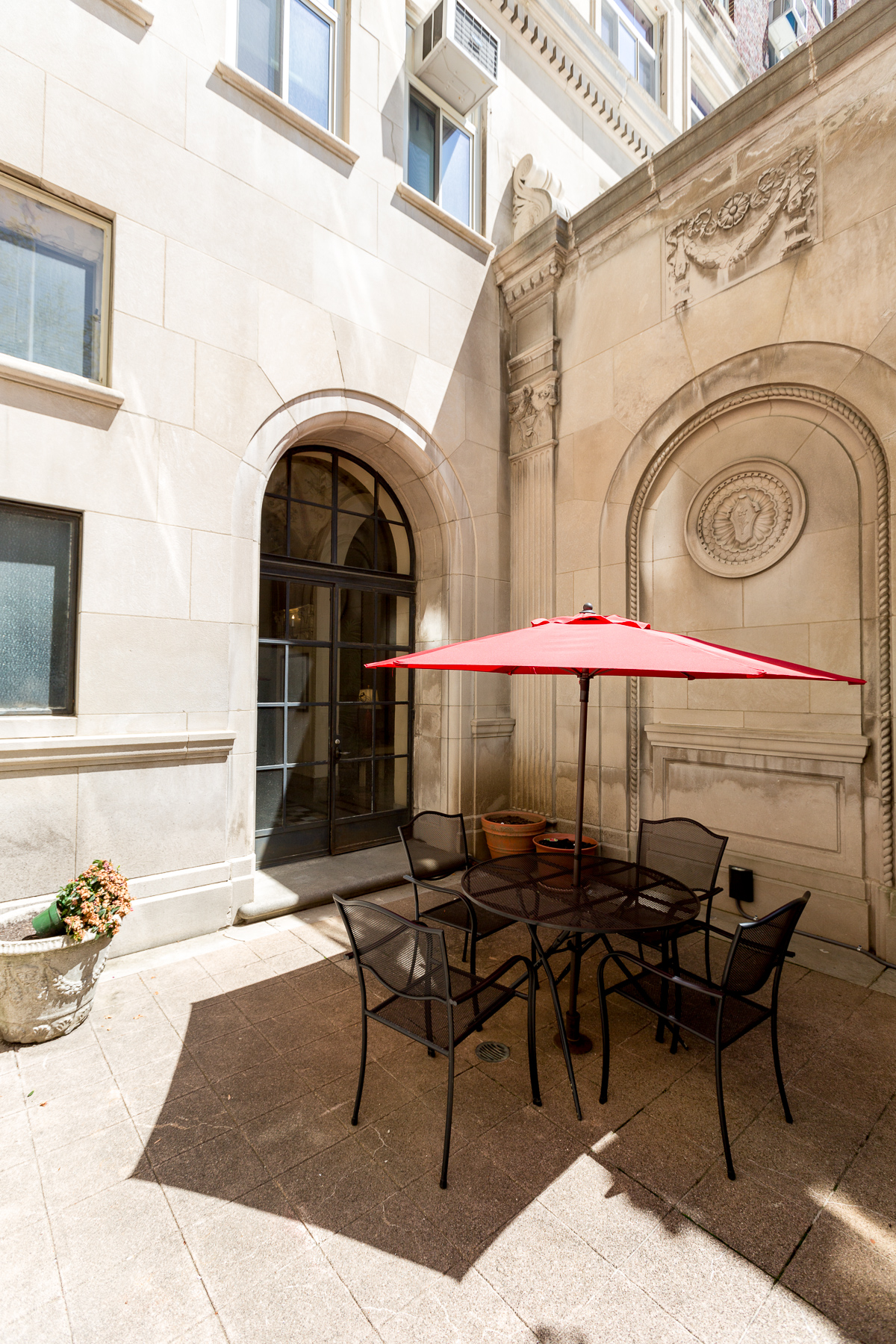An outdoor patio off of The Belvedere's main lobby / Image: Daniel Smyth Photography