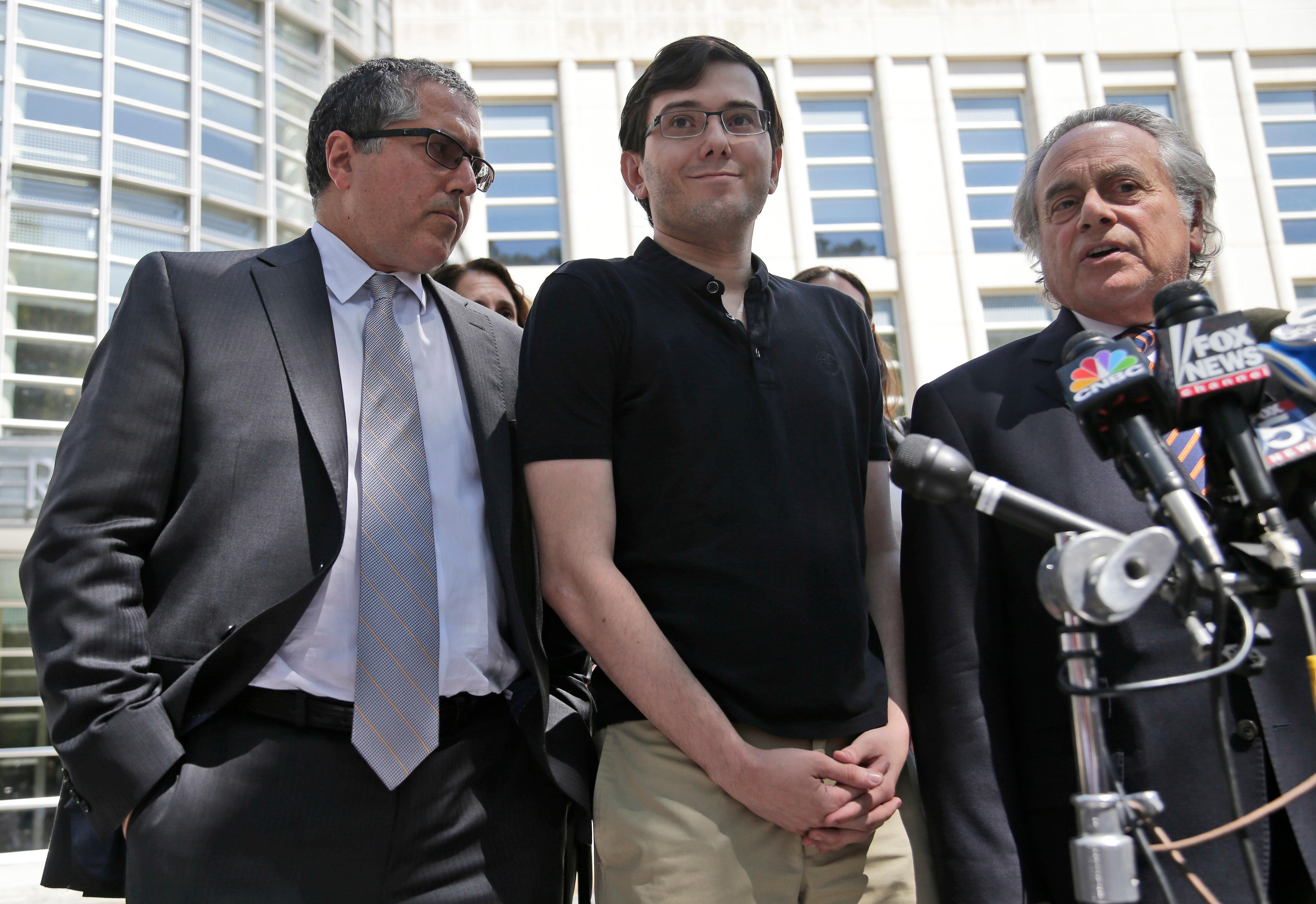 Martin Shkreli, center, stops with his attorneys to talk to reporters in front of federal court in New York, Friday, Aug. 4, 2017. The former pharmaceutical CEO has been convicted on federal charges he deceived investors in a pair of failed hedge funds. A Brooklyn jury deliberated five days before finding Shkreli guilty on Friday on three of eight counts. (AP Photo/Seth Wenig)