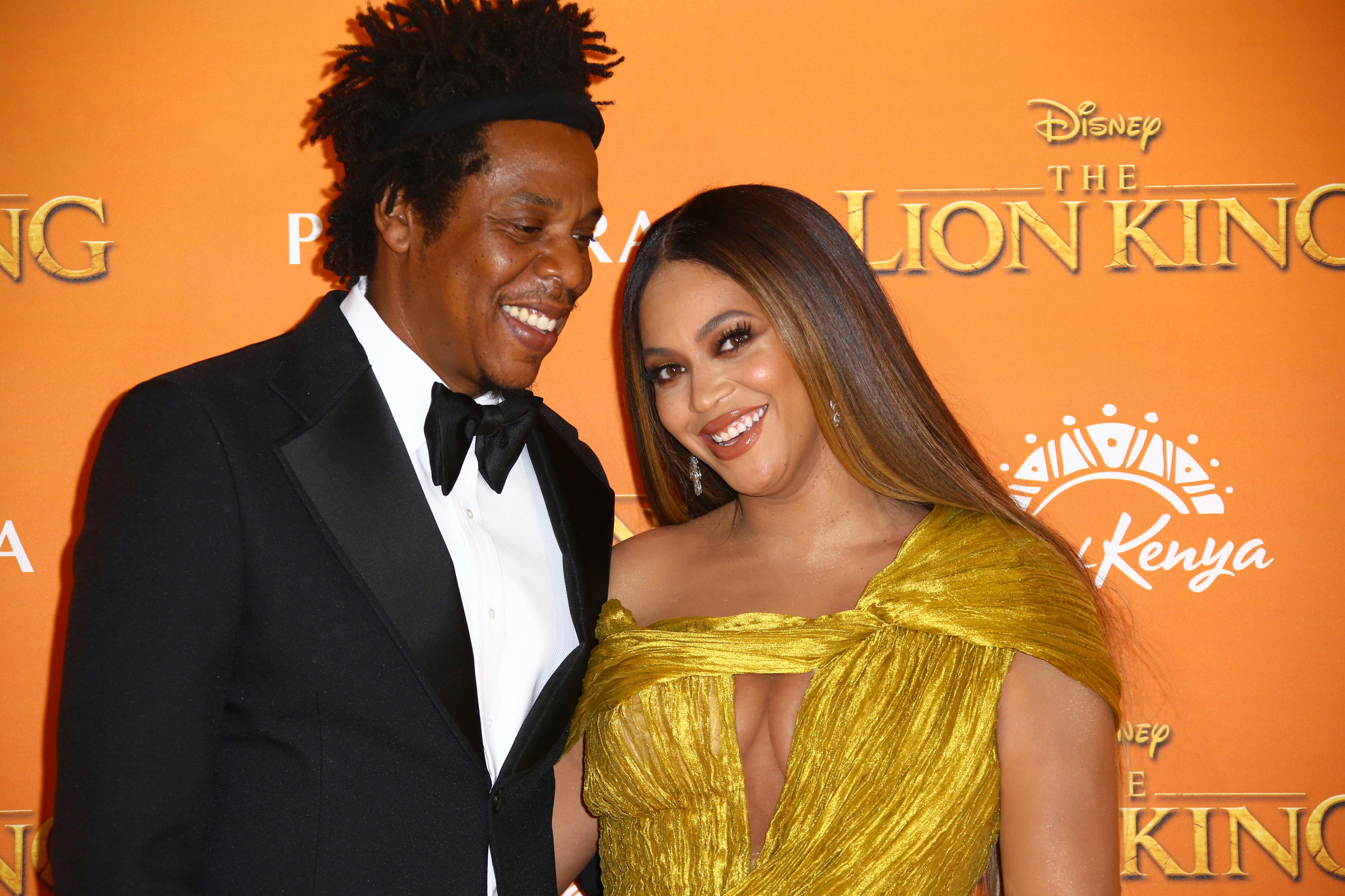 "FILE - In this July 14, 2019 file photo, singers Jay-Z, left, and Beyonce pose for photographers upon arrival at the ""Lion King"" European premiere in central London. (Photo by Joel C Ryan/Invision/AP, File)"