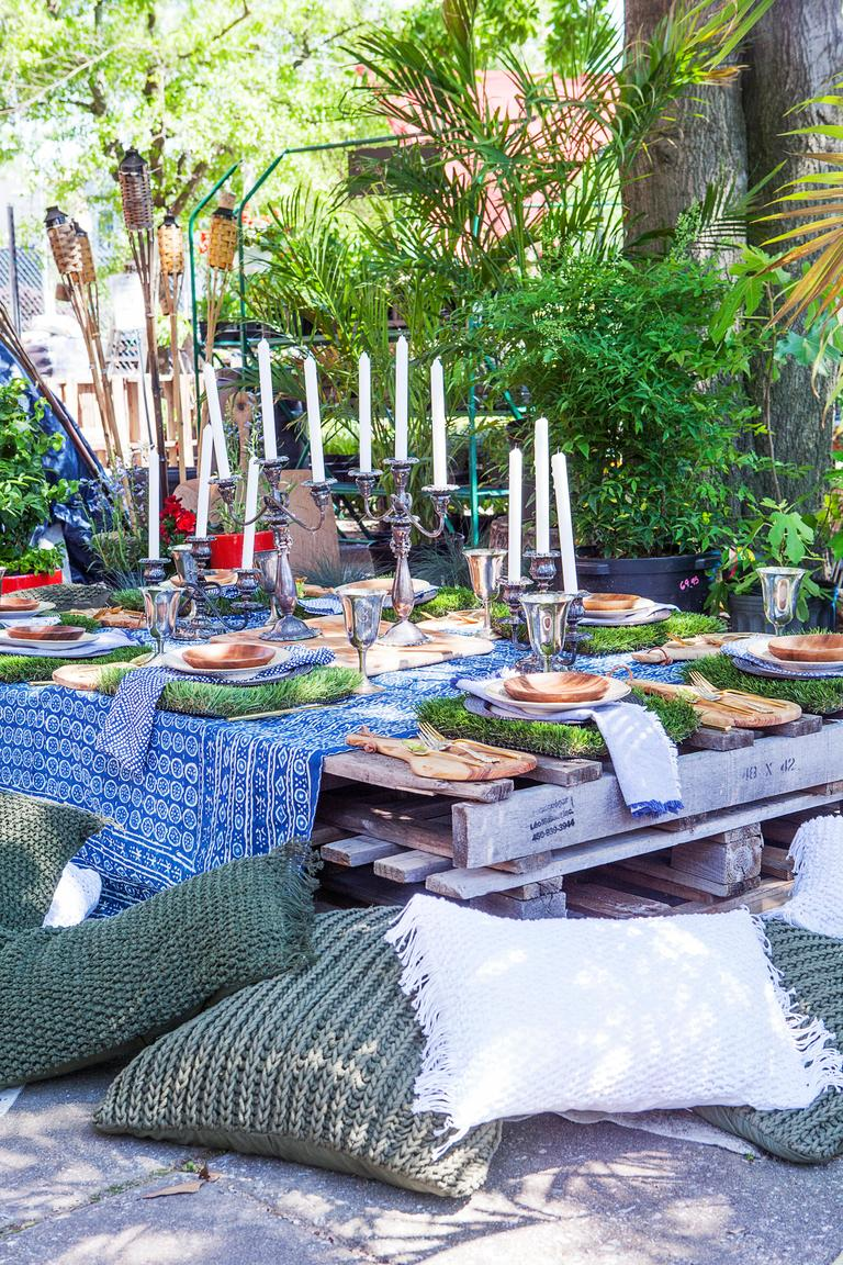"""I absolutely adore transforming outdoor spaces into over-the-top dining destinations -- there is something so special about creating an indoor feeling outside when you eat. I call this my Secret Garden Soirée."" See the full post here: http://bit.ly/2CYdq91 (Image: Ashley Hafstead)"