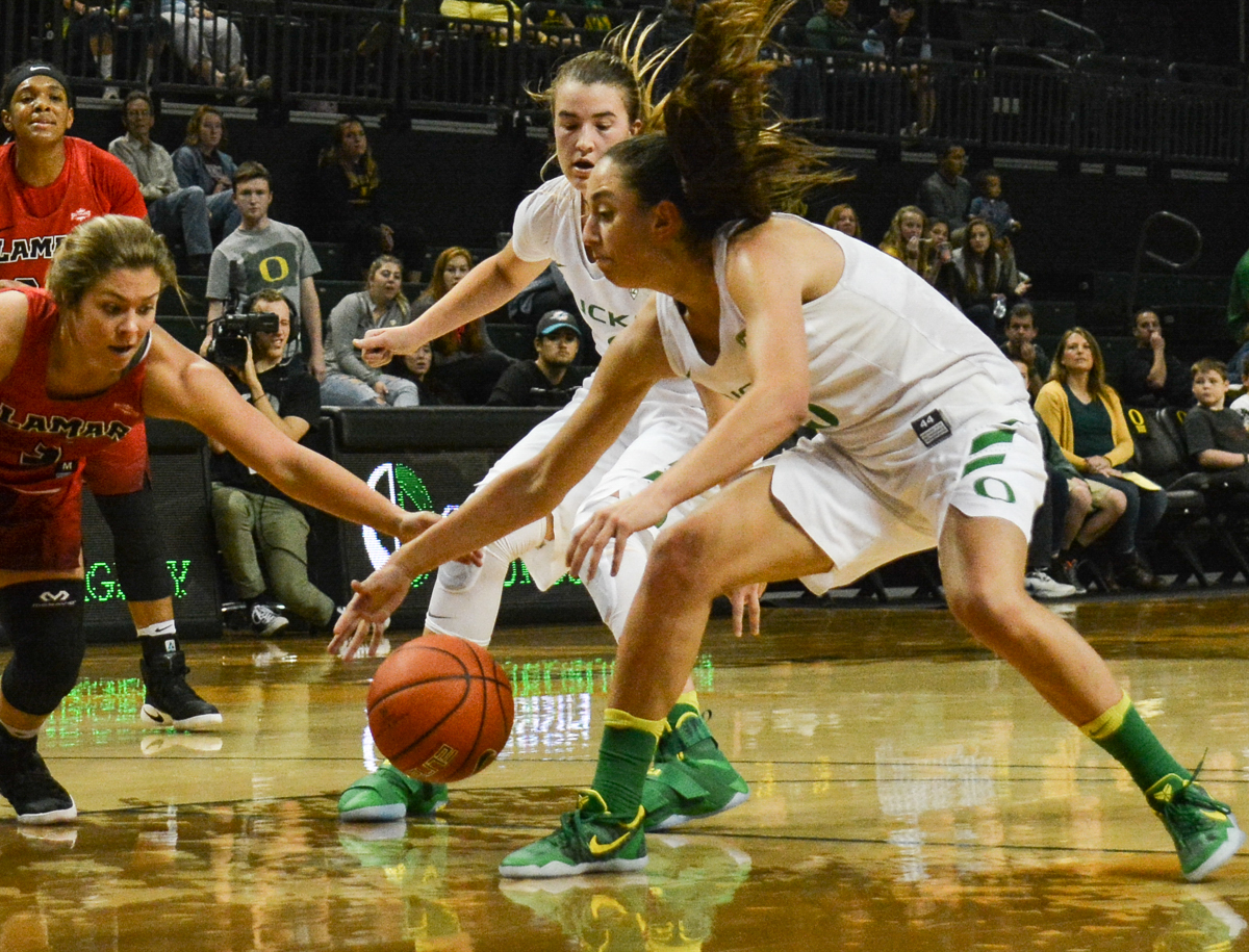 Ducks Maite Cazorla (#5) scoops up a loose ball. The Oregon Ducks women's basketball team won their season opener against the Lamar Cardinals 84-67. Photo by Jacob Smith, Oregon News Lab