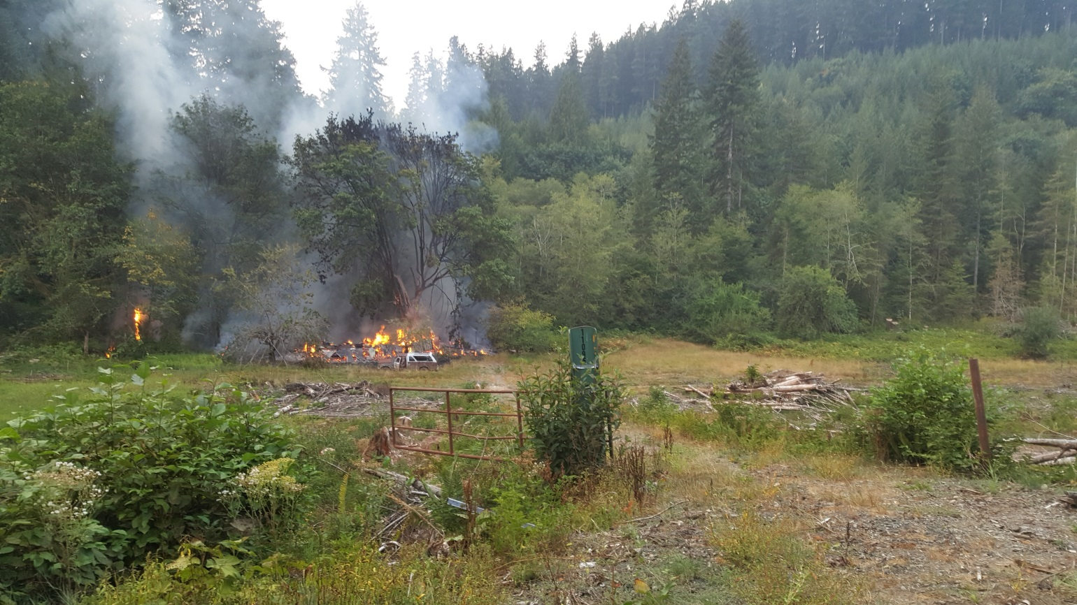 Three men were arrested in Douglas County following an investigation into a structure fire in an unoccupied building in a remote area of the North Fork Smith River on Sep. 2, 2017. (Oregon State Police photo)<p></p>