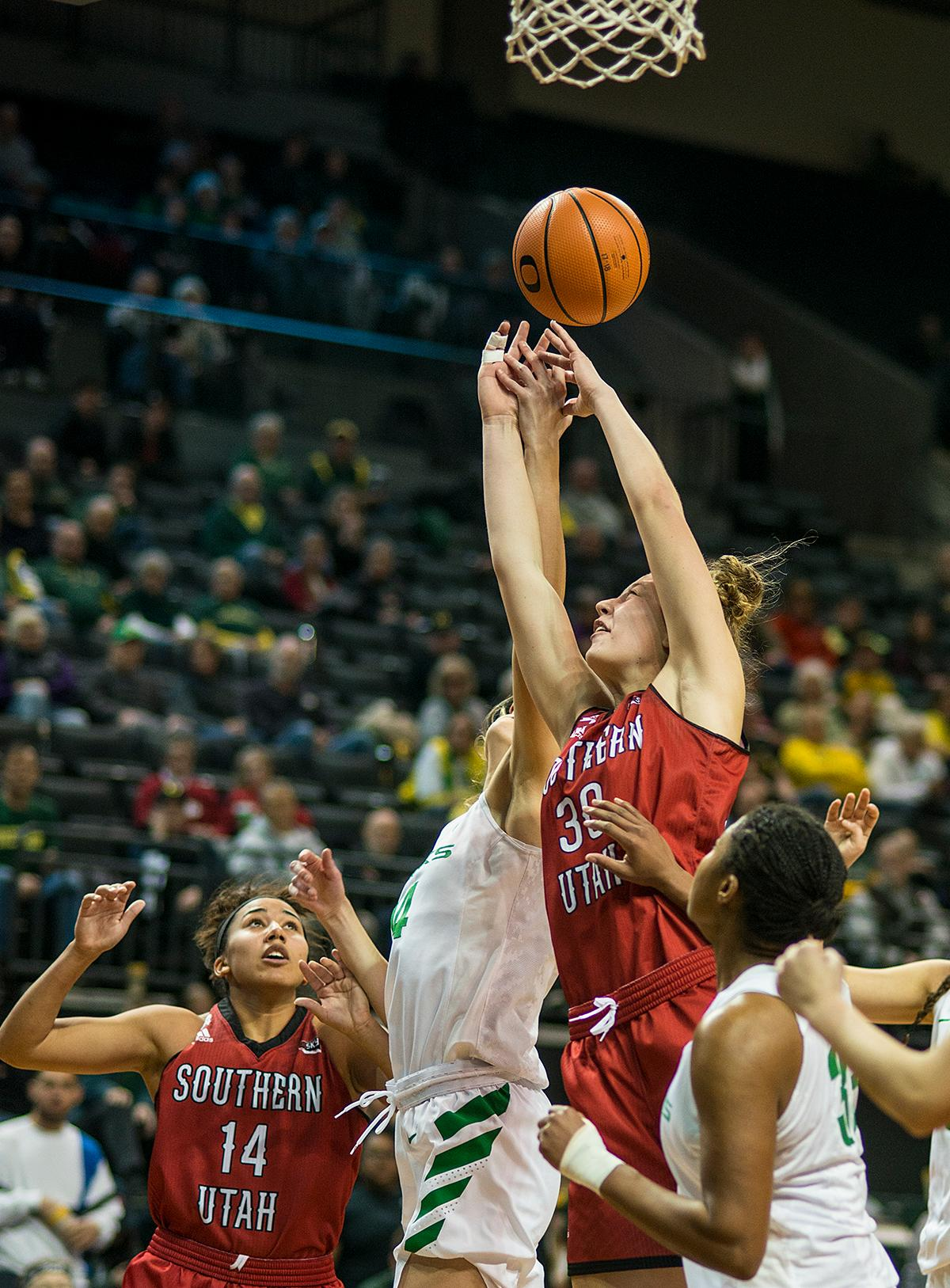 Southern Utah Thunderbirds Carlie Jones (#30) attempts to get the rebound. The University of Oregon Ducks women basketball team defeated the Southern Utah Thunderbirds 98-38 in Matthew Knight Arena Saturday afternoon. The Ducks had four players in double-digits: Ruthy Hebard with 13; Mallory McGwire with 10; Lexi Bando with 17 which included four three-pointers; and Sabrina Ionescu with 16 points. The Ducks overwhelmed the Thunderbirds, shooting 50% in field goals to South Utah's 26.8%, 53.8% in three-pointers to 12.5%, and 85.7% in free throws to 50%. The Ducks, with an overall record of 8-1, and coming into this game ranked 9th, will play their next home game against Ole Miss on December 17. Photo by Rhianna Gelhart, Oregon News Lab