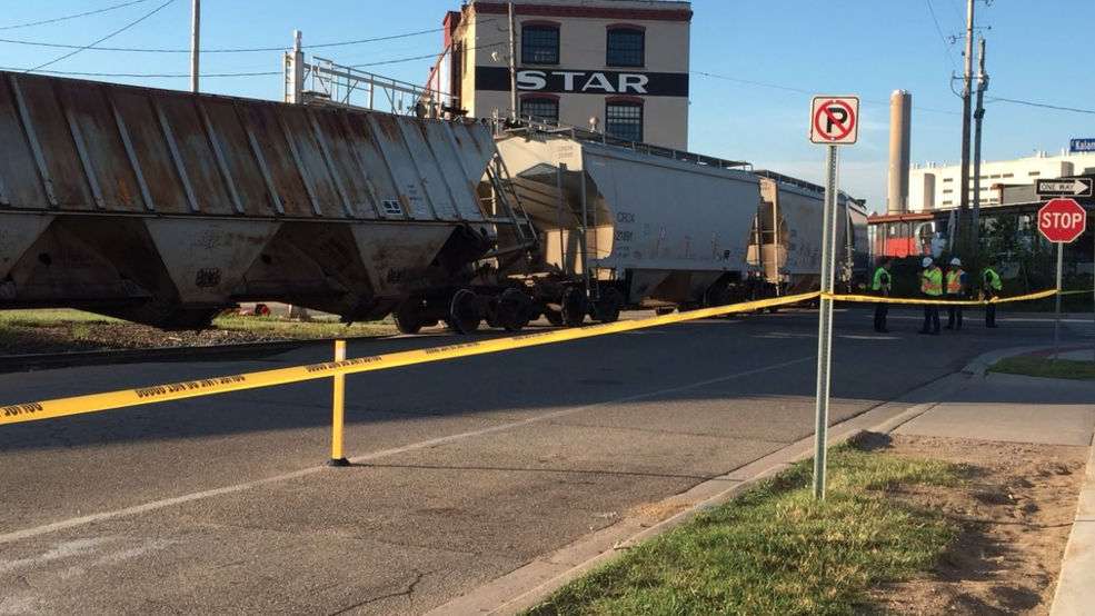 Major train derailment shuts down roads in downtown