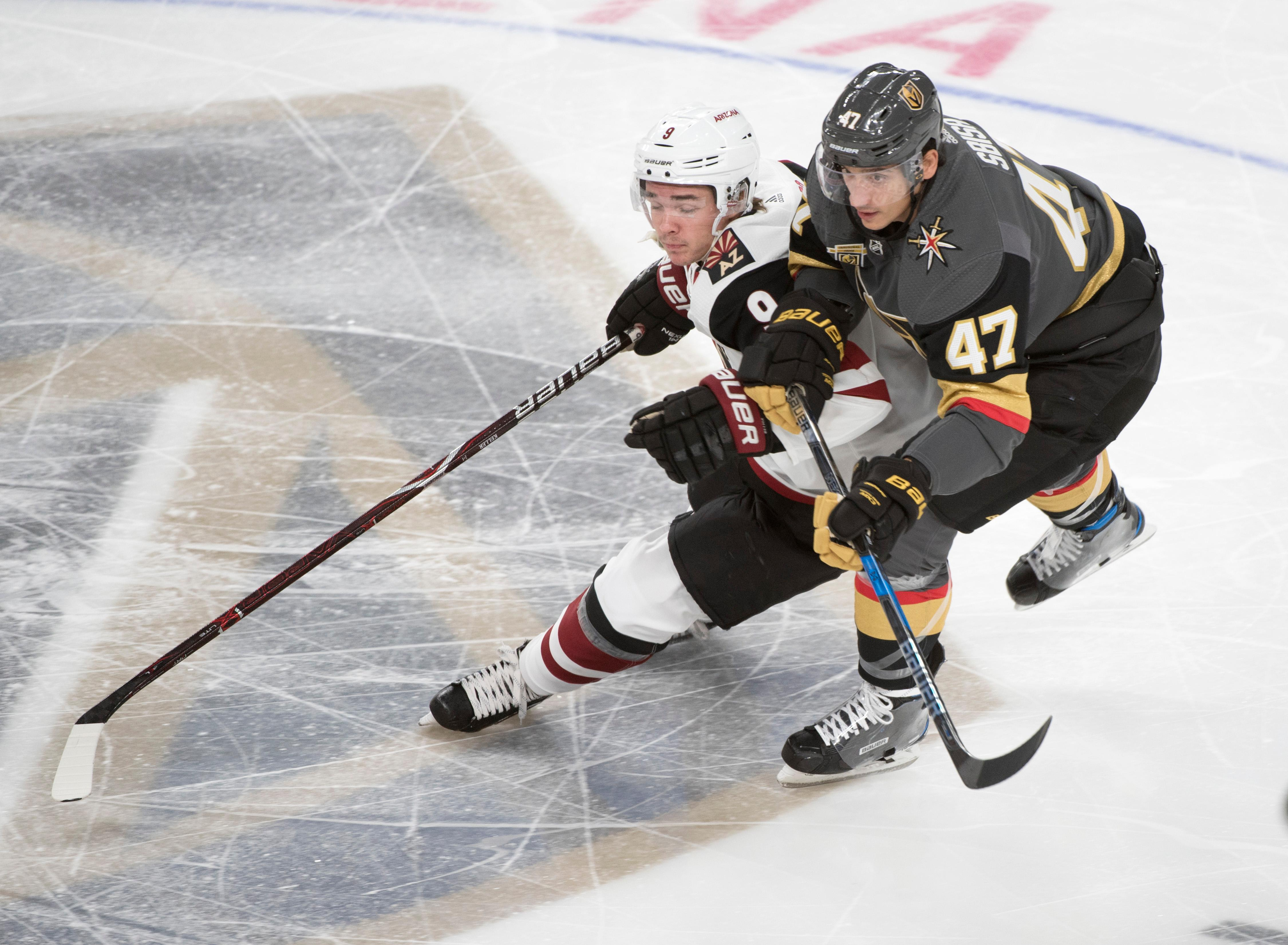 Arizona Coyotes wing Clayton Keller (9) and Vegas Golden Knights defenseman Luca Sbisa (47) fight for the puck during the Knights home opener Tuesday, Oct. 10, 2017, at the T-Mobile Arena. The Knights won 5-2 to extend their winning streak to 3-0. CREDIT: Sam Morris/Las Vegas News Bureau