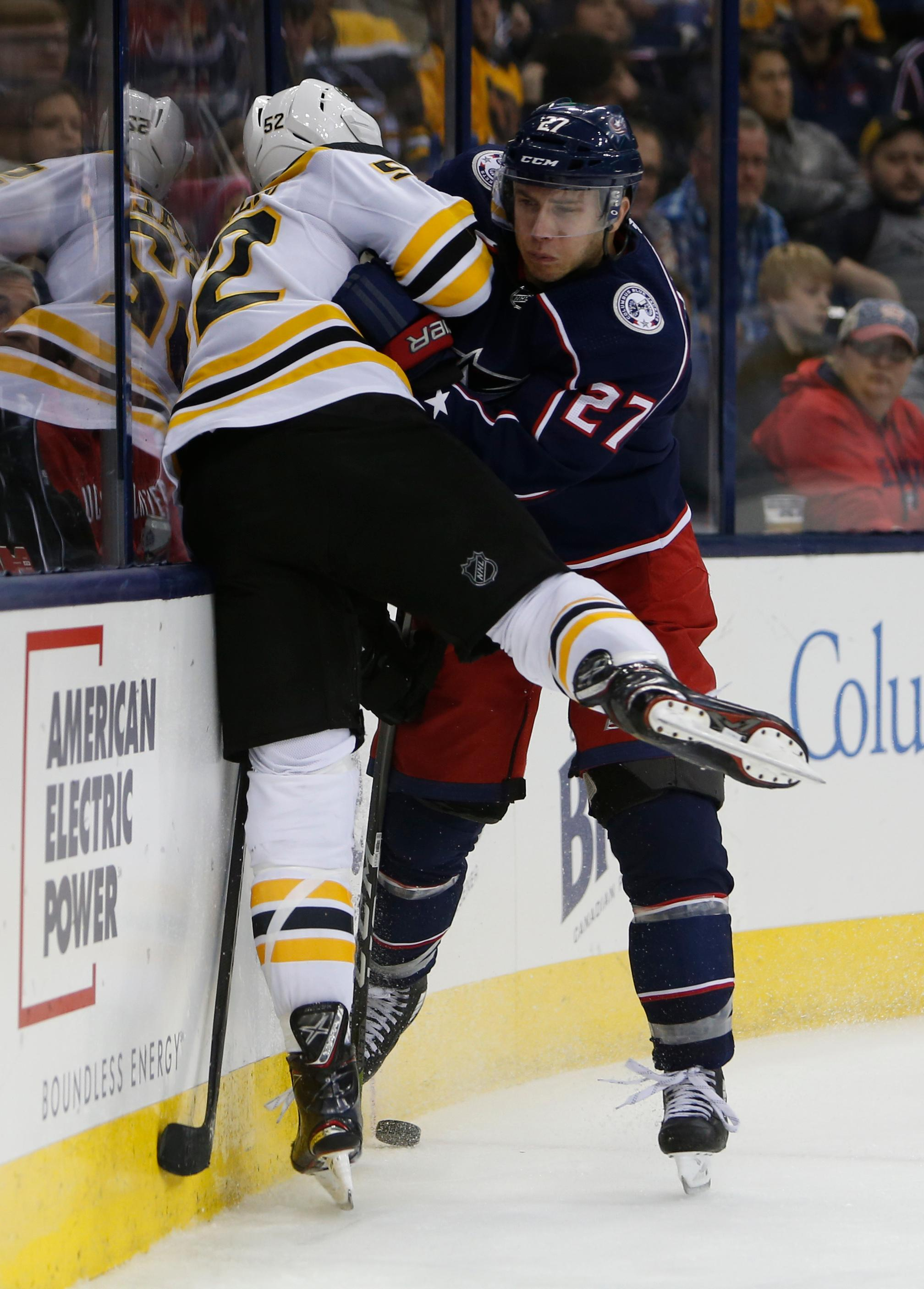 Columbus Blue Jackets' Ryan Murray, right, checks Boston Bruins' Sean Kuraly during the third period of an NHL hockey game Monday, Oct. 30, 2017, in Columbus, Ohio. The Blue Jackets beat the Bruins 4-3 in a shootout. (AP Photo/Jay LaPrete)
