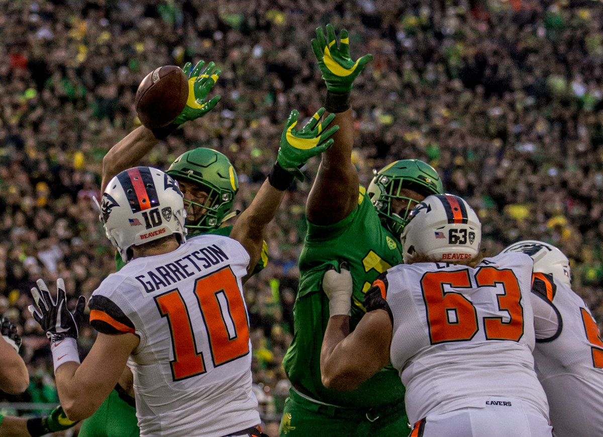 Oregon defensive player Troy Dye (#35) blocks a pass thrown by Oregon State quarterback Darell Garretson (#10). The Oregon Ducks lead the Oregon State Beavers 52 to 7 at the end of the first half of the 121st Civil War game on Saturday, November 25, 2017 at Autzen Stadium in Eugene, Ore. Photo by Ben Lonergan, Oregon News Lab