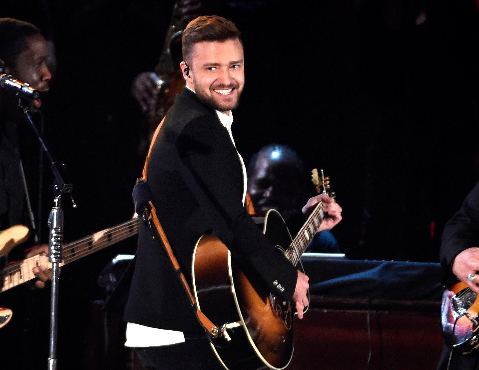 "FILE - In this Nov. 4, 2015 file photo, Justin Timberlake performs at the 49th annual CMA Awards in Nashville, Tenn. A watchdog group is politely pleading with Timberlake to keep his Super Bowl halftime show ""safe for the children watching."" In an open letter to the entertainer issued Tuesday, Jan. 30, 2018, the Parents Television Council hopes there isn't a repeat of what happened in 2004 when Timberlake ripped Janet Jackson's costume to reveal her right breast. (Photo by Chris Pizzello/Invision/AP, File)"