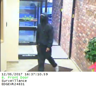 "Ithaca Police have released surveillance photos of the suspect in the bank robbery that occurred on Tuesday December 5th, 2017 at the Tompkins County Trust Company. The suspect is described  as a 5'10"" black man wearing dark clothing."