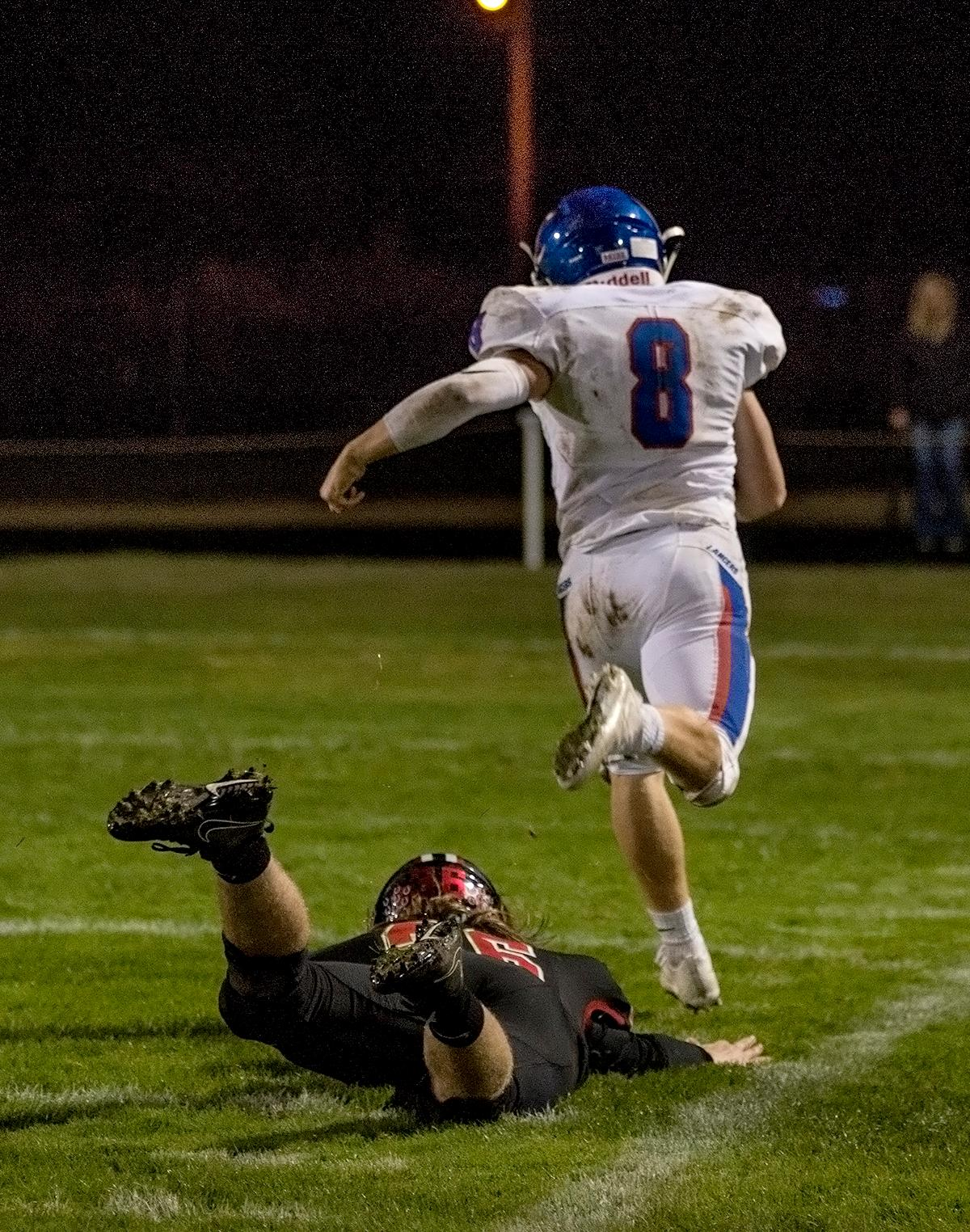 Thurston Colts linebacker Wes Kommer (#36) attempts to tackle Churchill Lancers running back Dalton McDaniel (#8).                                    The Churchill Lancers defeated the Thurston Colts 40–35 at Thurston high school on Friday night, September 29th. Photo by Abigail Winn, Oregon News Lab