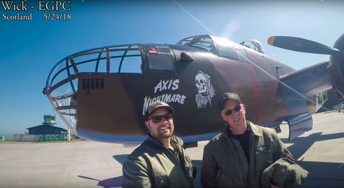 "Crew Chief Mike Durkee and Pilot Paul Redlich in front of ""Axis Nightmare"" aka ""Yankee Doodle"" during a stop in Scotland as they brought the B-25 to Italy for filming. / Image courtesy of the Tri-State Warbird Museum // Published: 10.15.19"