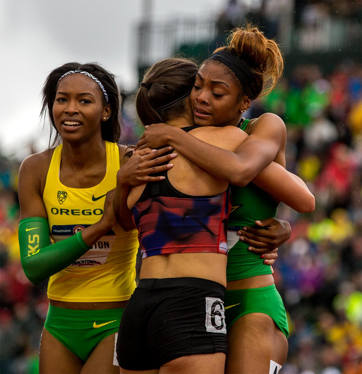 Oregon graduate Jenna Prandini is congratulated by her fellow Oregon students Arianna Washington (left) and Deajah Stevens (right) Prandini finished third in the 200 meters and Steven finished second. Both will be headed to Rio to fight for gold. Photo by August Frank, Oregon News Lab