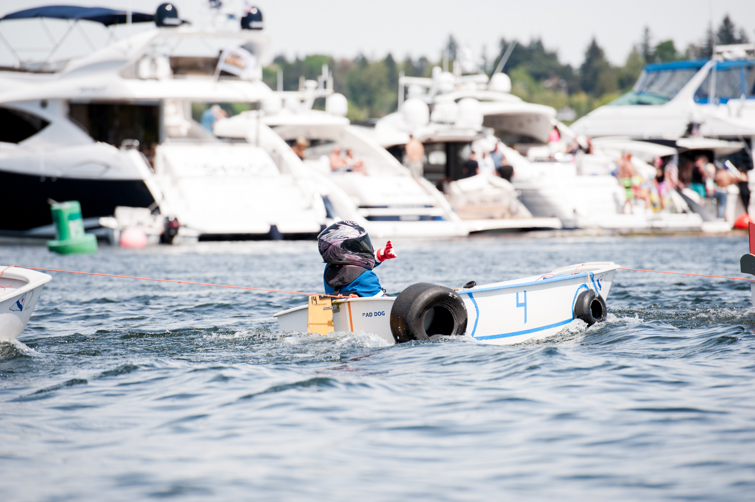<p>Seattle Yacht Club Opening Day is always the first Saturday in May, and marked with by the Windermere Cup crew races, sailboat races and the Opening Day Parade. It's easily become the nation's largest regional celebration of water, spring and the opening of boating season. (Image: Elizabeth Crook / Seattle Refined)</p>