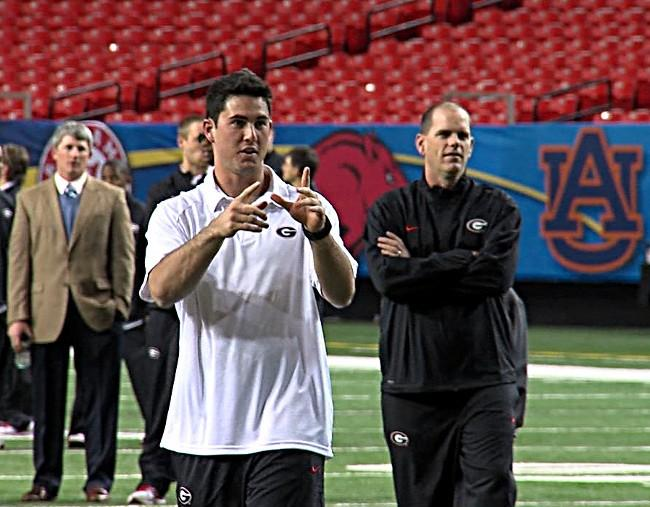 Georgia quarterback Aaron Murray and offensive coordinator Mike BoBo during a walk through at the Georgia Dome on Friday.
