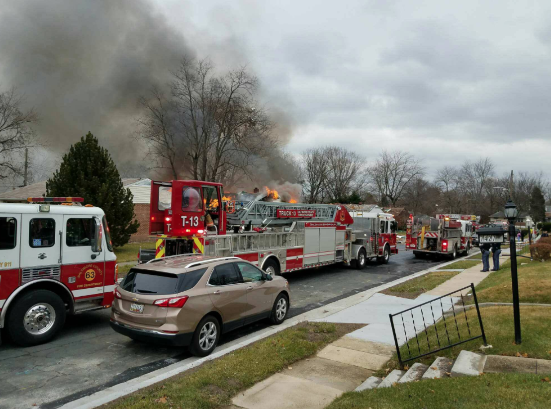 Fire officials are on the scene of a house fire and explosion in a neighborhood Baltimore, Md.{ } Tuesday, Dec. 5, 2017 (Photo courtesy of Baltimore County Police and Fire Department/Twitter){ }