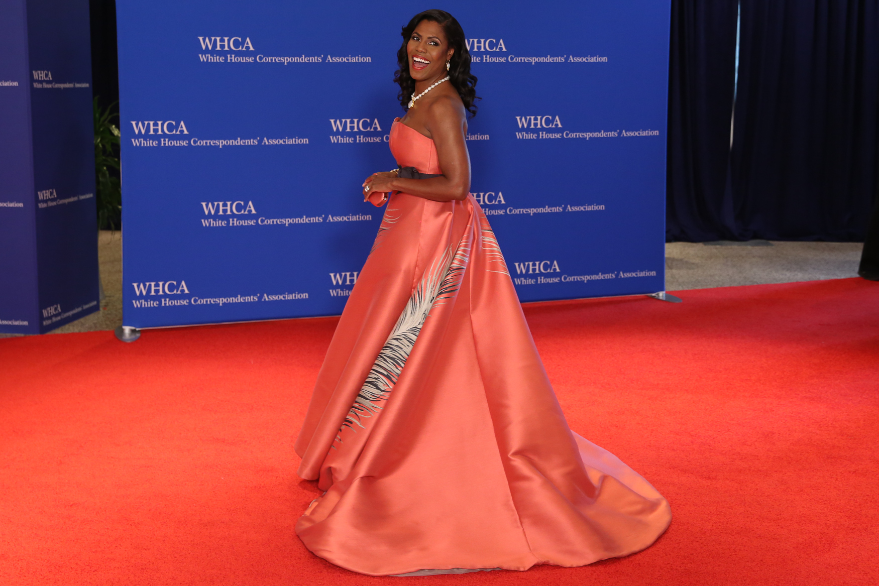 Omarosa may be out of the White House, but she came to the dinner dressed with a vengeance. That color is perfect on her skin and the silhouette is as dramatic as she was on The Apprentice.{ }(Amanda Andrade-Rhoades/DC Refined)