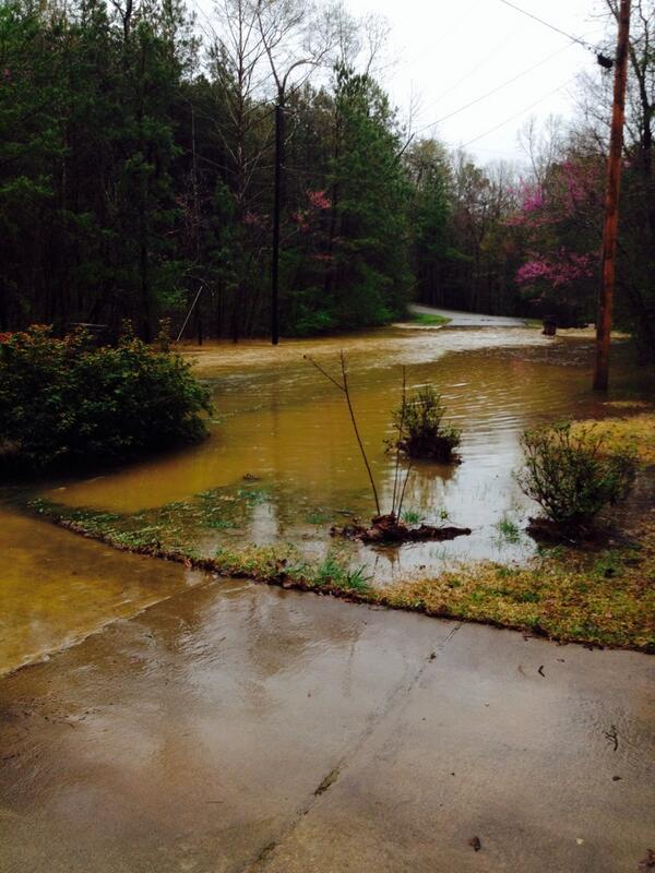 Flash flooding covers a road in McCalla, Ala., Monday, April 7, 2014.