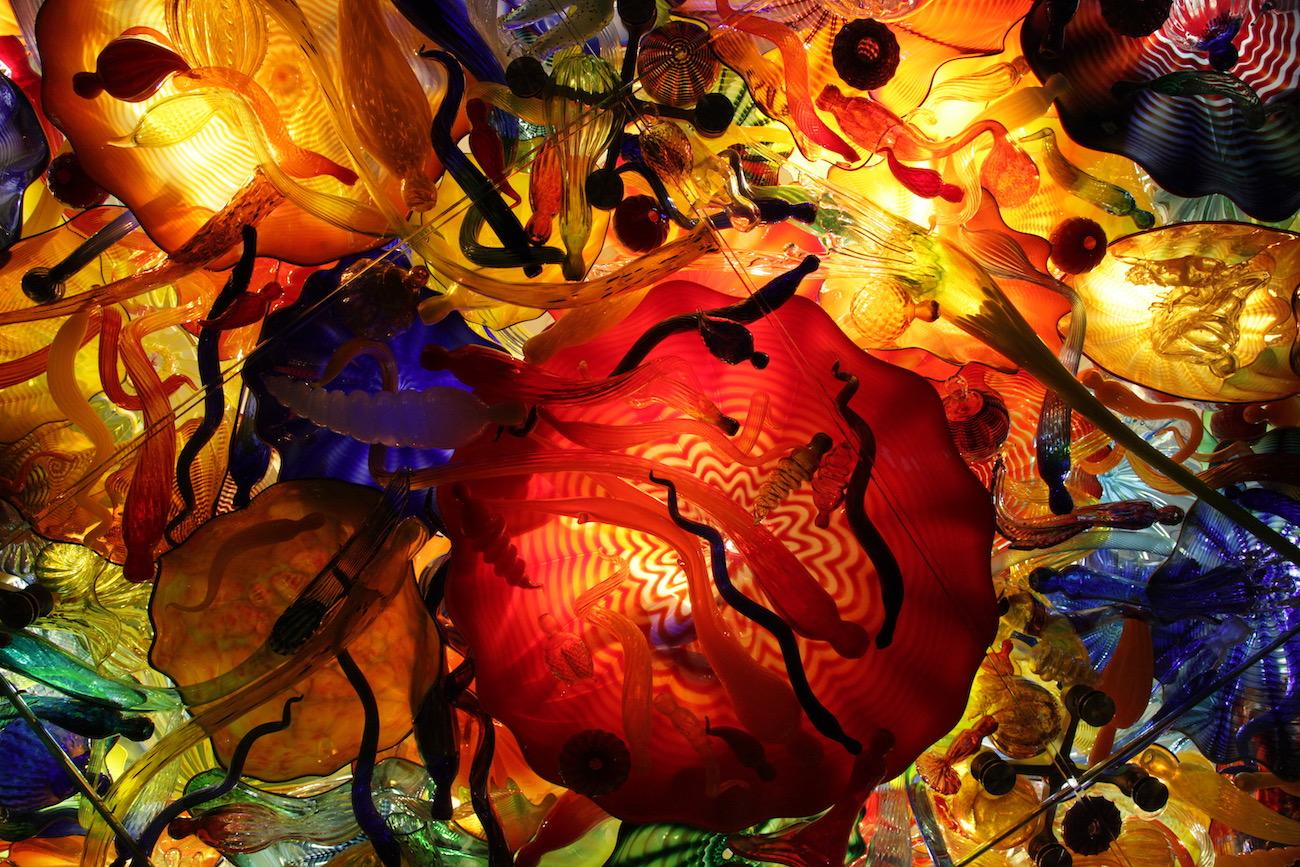 The view from below Dale Chihuly's largest, permanent installation of 3,200 intertwined blown glass pieces standing over 40 feet tall in the museum / Image: Chez Chesak // Published: 4.2.19
