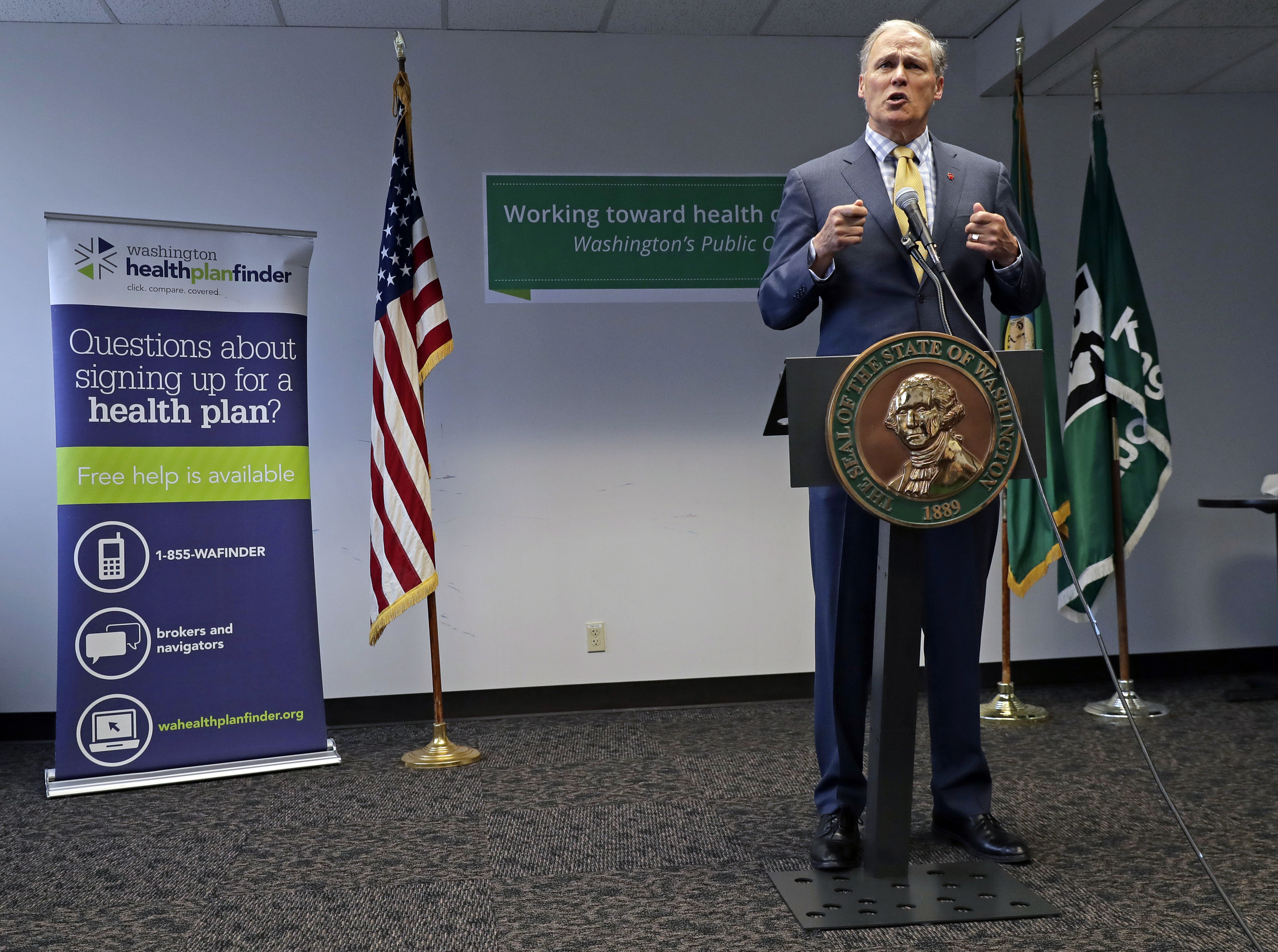 FILE - In this Tuesday, Jan. 8, 2019, file photo, Washington Gov. Jay Inslee answers questions from reporters at a news conference in Seattle. Gov. Inslee proposed a public health insurance option for people who are not covered by Medicaid or private employers and have trouble affording policies on the private market. Democrats in several other states are considering ways that people who are uninsured but make too much to qualify for Medicaid or other subsidized coverage can buy Medicaid policies. (AP Photo/Ted S. Warren, File)