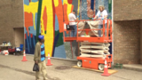 44-year-old mural in downtown Kalamazoo receives rejuvenation from original artist