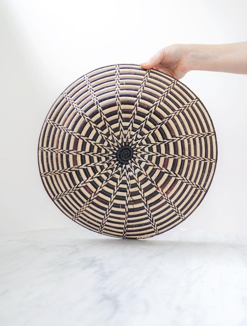 "This stylish African basket would look great on a console table as a ""catch all"" basket. It can also be used as a bread basket or simply displayed as art. https://etsy.me/2ClsmPN (Image: Ashley Hafstead)"