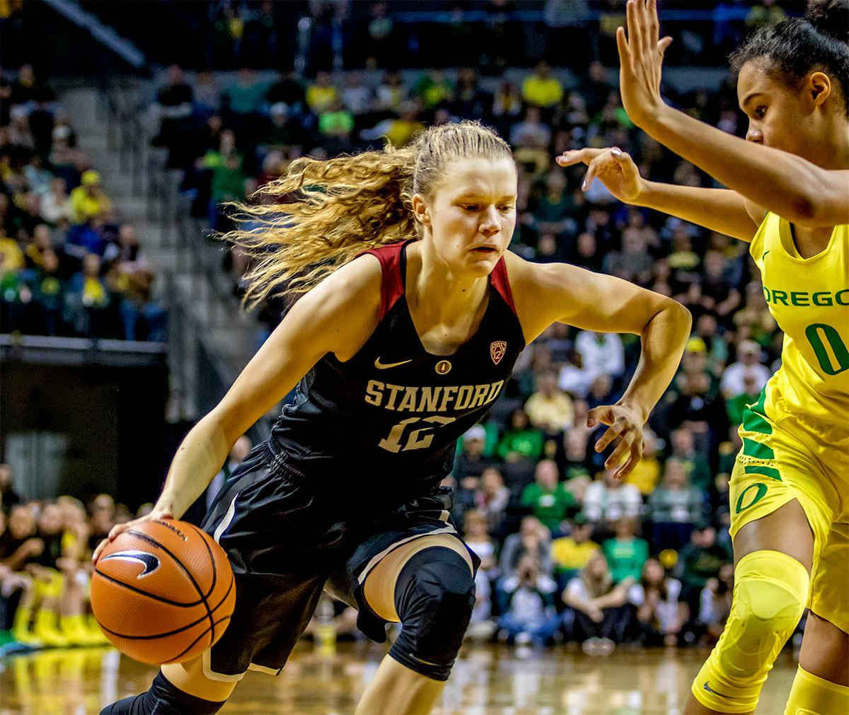The Cardinal's Brittany Smith (#12) makes a run for the basket. The Stanford Cardinal defeated the Oregon Ducks 78-65 on Sunday afternoon at Matthew Knight Arena. Stanford is now 10-2 in conference play and with this loss the Ducks drop to 10-2. Leading the Stanford Cardinal was Brittany McPhee with 33 points, Alanna Smith with 14 points, and Kiana Williams with 14 points. For the Ducks Sabrina Ionescu led with 22 points, Ruthy Hebard added 16 points, and Satou Sabally put in 14 points. Photo by August Frank, Oregon News Lab