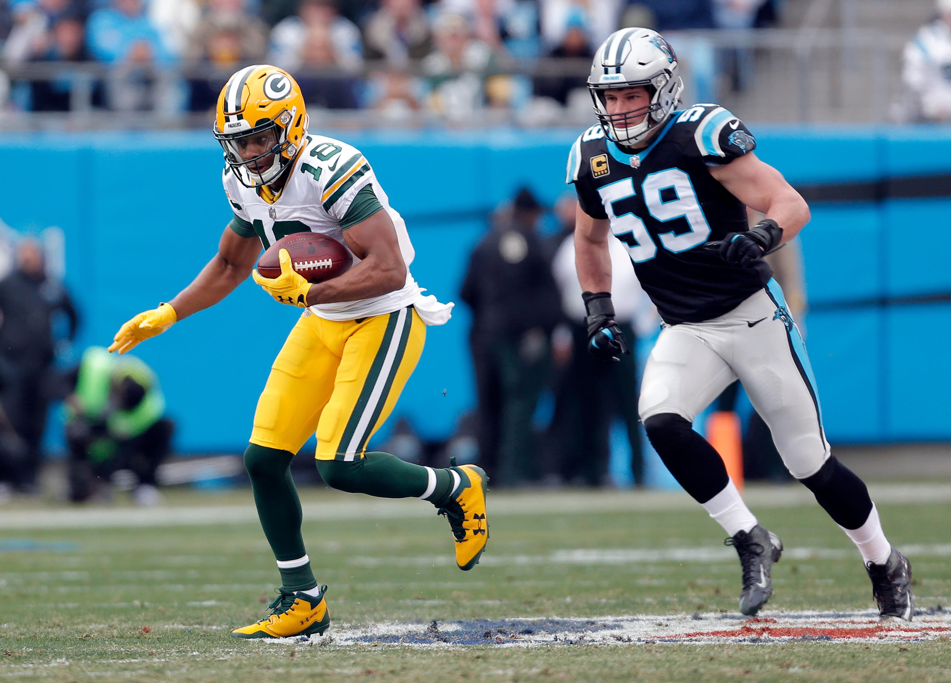 Green Bay Packers' Randall Cobb (18) runs past Carolina Panthers' Luke Kuechly (59) after a catch during the first half of an NFL football game in Charlotte, N.C., Sunday, Dec. 17, 2017. (AP Photo/Bob Leverone)