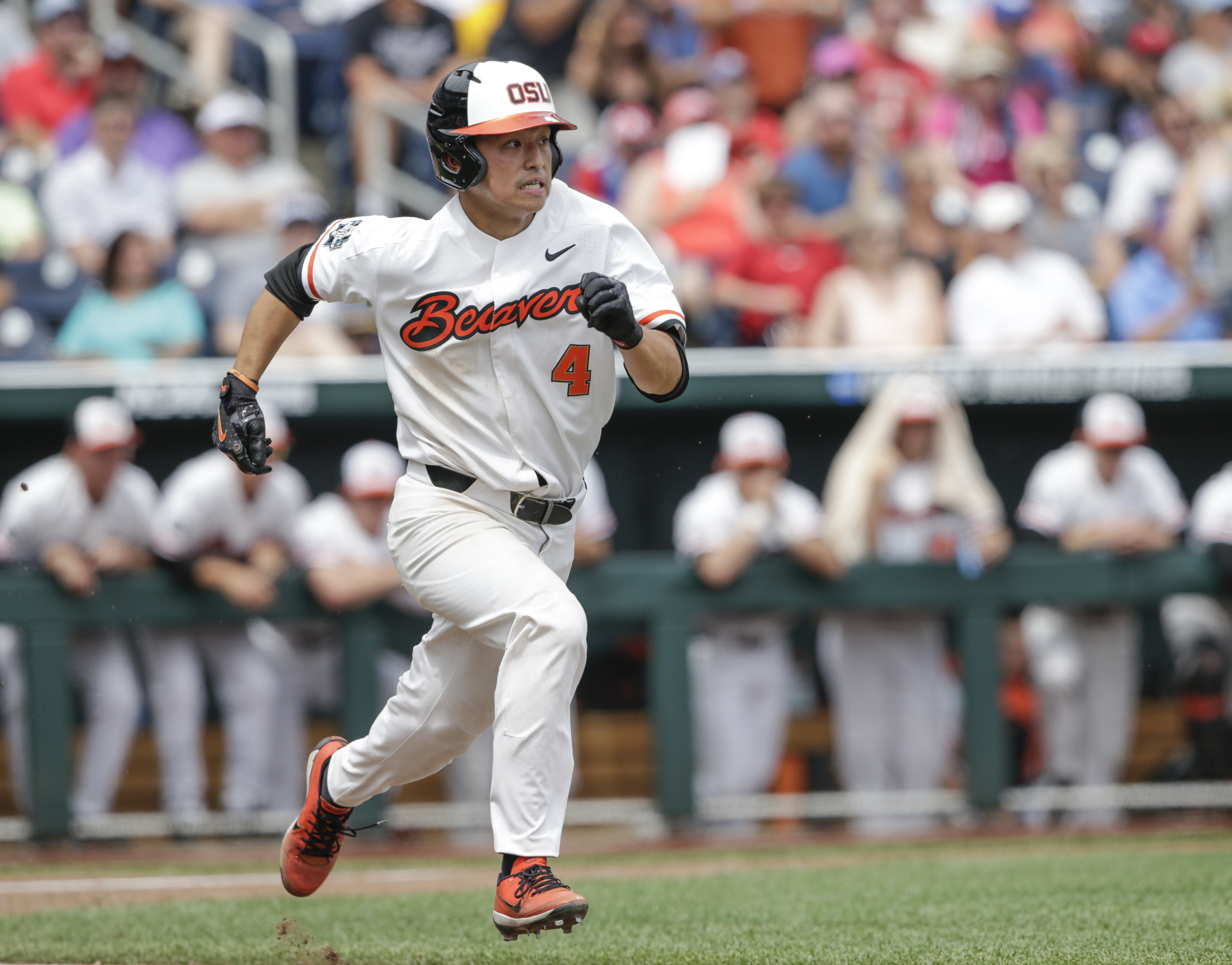 Oregon State's Steven Kwan runs to first base on a one-run single during the second inning of an NCAA mens College World Series baseball game against Cal State Fullerton in Omaha, Neb., Saturday, June 17, 2017. Michael Gretler scored on the play. (AP Photo/Nati Harnik)