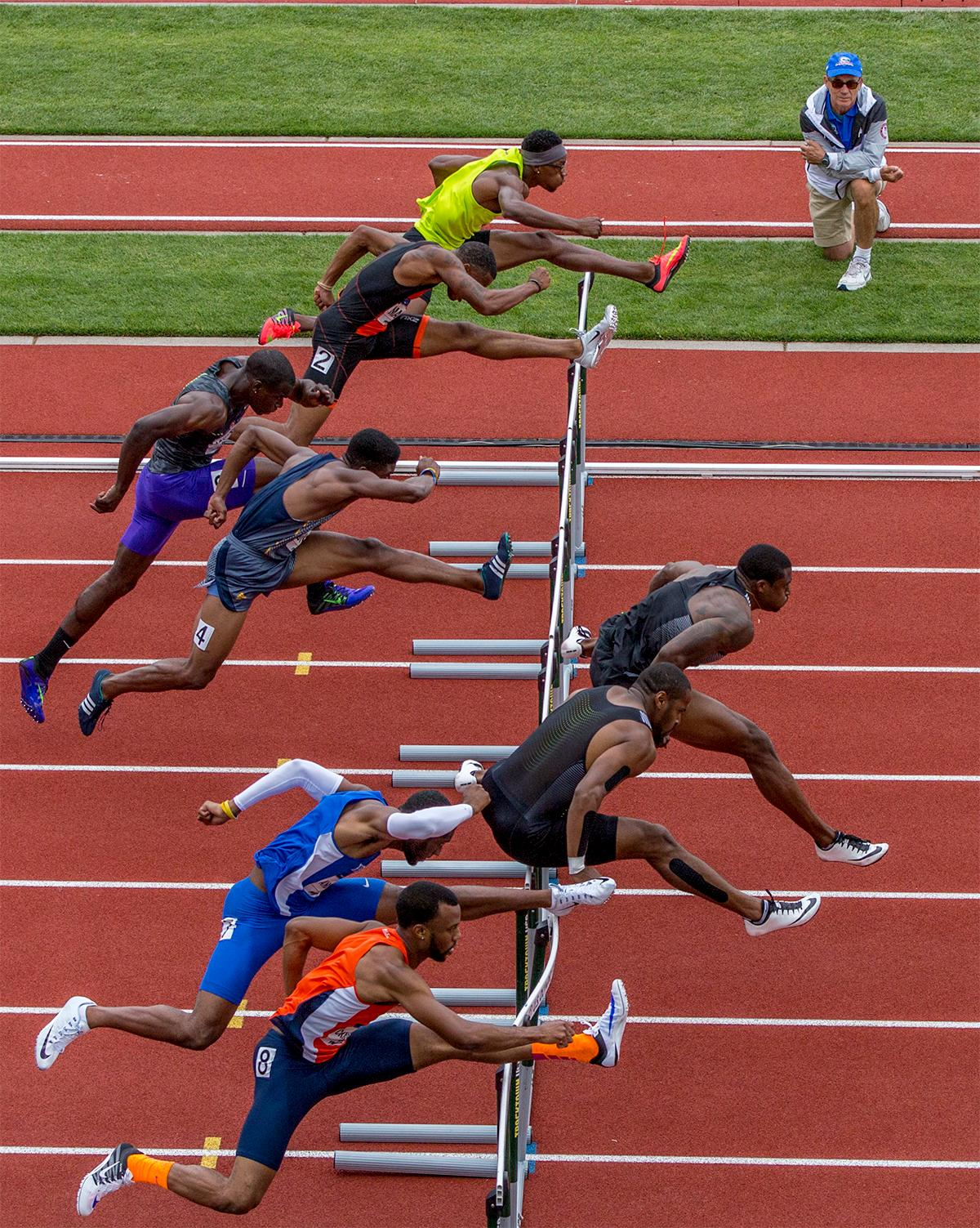 Athletes in a  heat of the 110 meter hurdles sprint down the straightaway in the semi-finals. Adidas Ronnie Ash had the fastest time, of 13.39, in the semi-finals. Photo by August Frank, Oregon News Lab