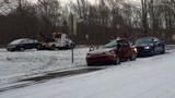 Driver hospitalized after crash on slick roads
