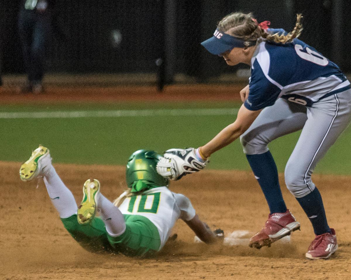 Oregon Duck Alexis Mack (#10) safely slides into second as Chicago Flames Kayla Wedl (#6) attempts to tag her out. The No. 3 Oregon Ducks defeated the University of Illinois Chicago Flames 13-0 with the run-rule on Saturday night at Jane Sanders Stadium. The Ducks scored in every inning and then scored nine runs at the bottom of the fourth. The Oregon Ducks are now 22-0 in NCAA regional games. The Oregon Ducks play Wisconsin next on Saturday, May 20 at 2pm at Jane Sanders Stadium. Photo by Cheyenne Thorpe, Oregon News Lab