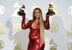 "Beyonce poses in the press room with the awards for best music video for ""Formation"" and best urban contemporary album for ""Lemonade"" at the 59th annual Grammy Awards at the Staples Center on Sunday, Feb. 12, 2017, in Los Angeles. (Photo by Chris Pizzello/Invision/AP)"