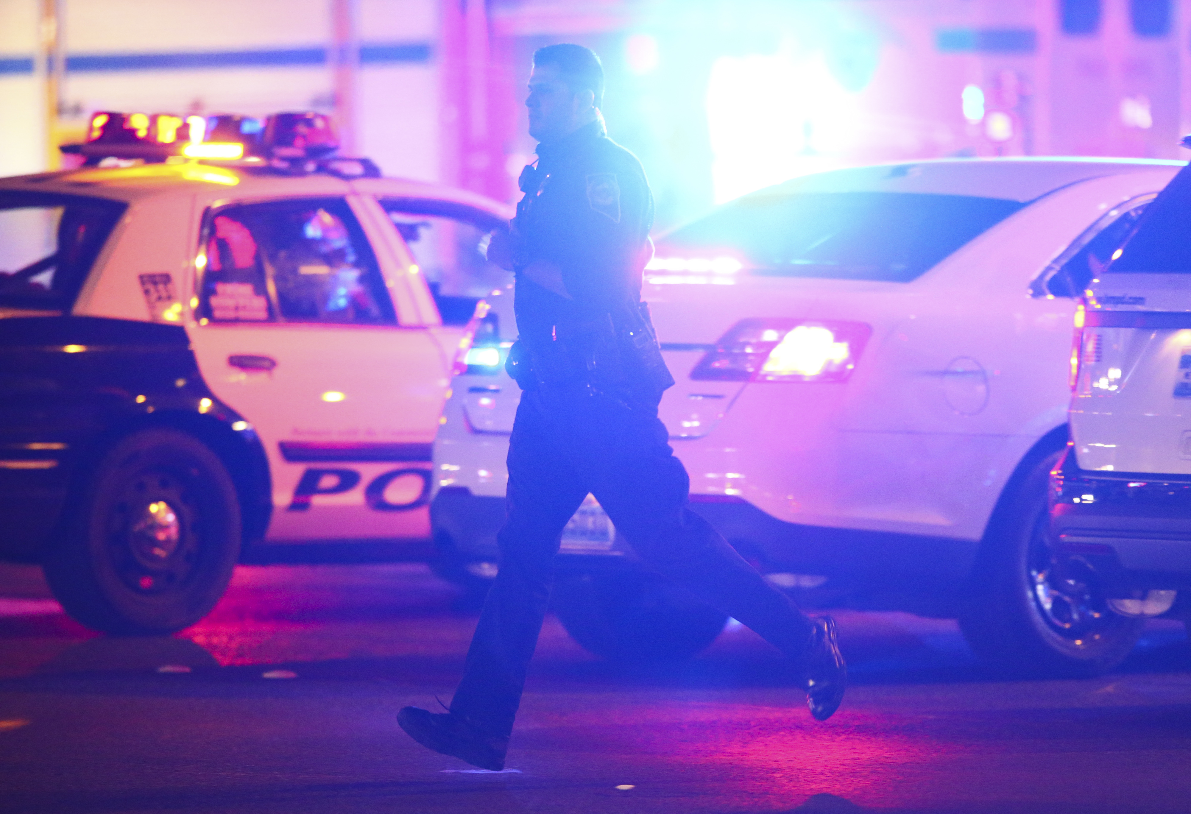 Las Vegas police respond during an active shooter situation on the Las Vegas Strip near Tropicana Avenue in Las Vegas Sunday, Oct. 1, 2017. Multiple victims were being transported to hospitals after a shooting late Sunday at a music festival on the Las Vegas Strip.  (Chase Stevens/Las Vegas Review-Journal via AP)