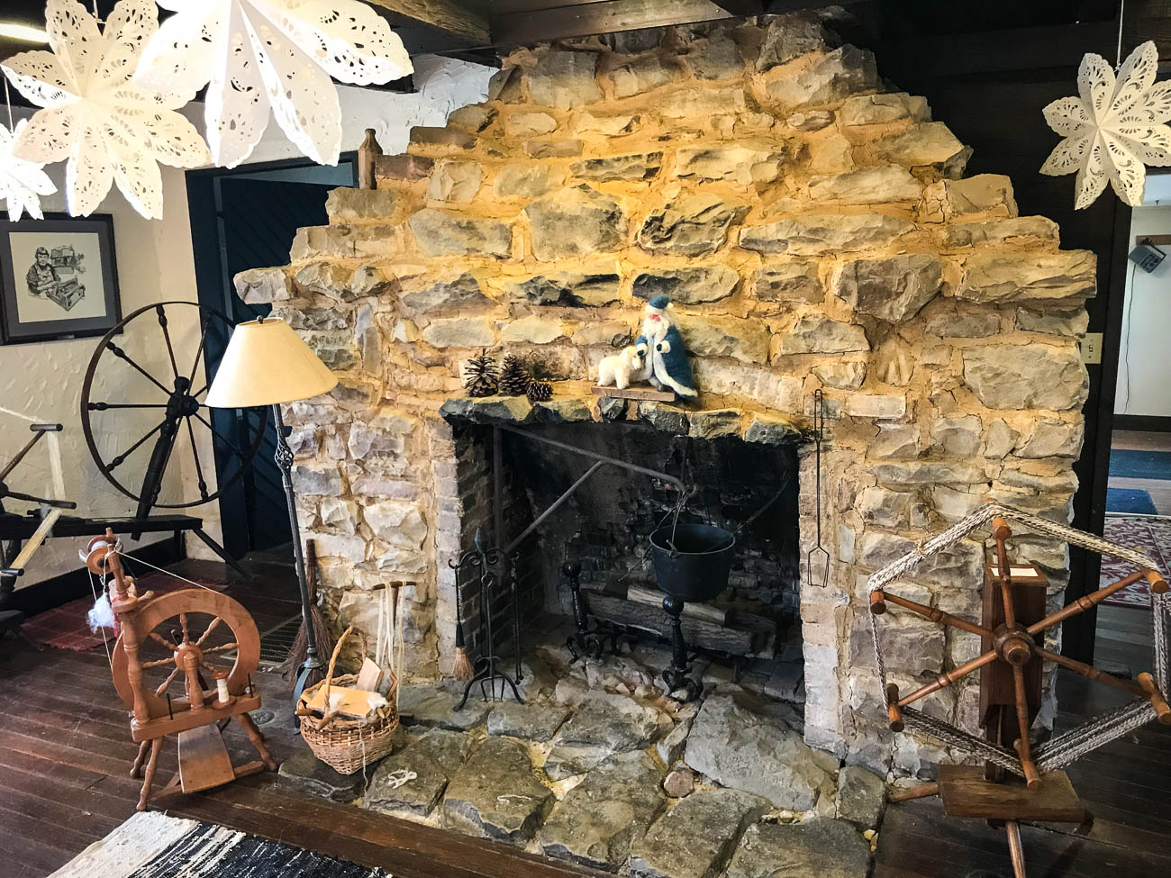 The original cabin on the site was built by Beoni Figg in the 1860s and served as his office for his rock quarry business. The enormous fire place in the middle of the cabin showcases the rocks that were extracted during his time there. / Image: Katie Robinson, Cincinnati Refined // Published: 12.15.18