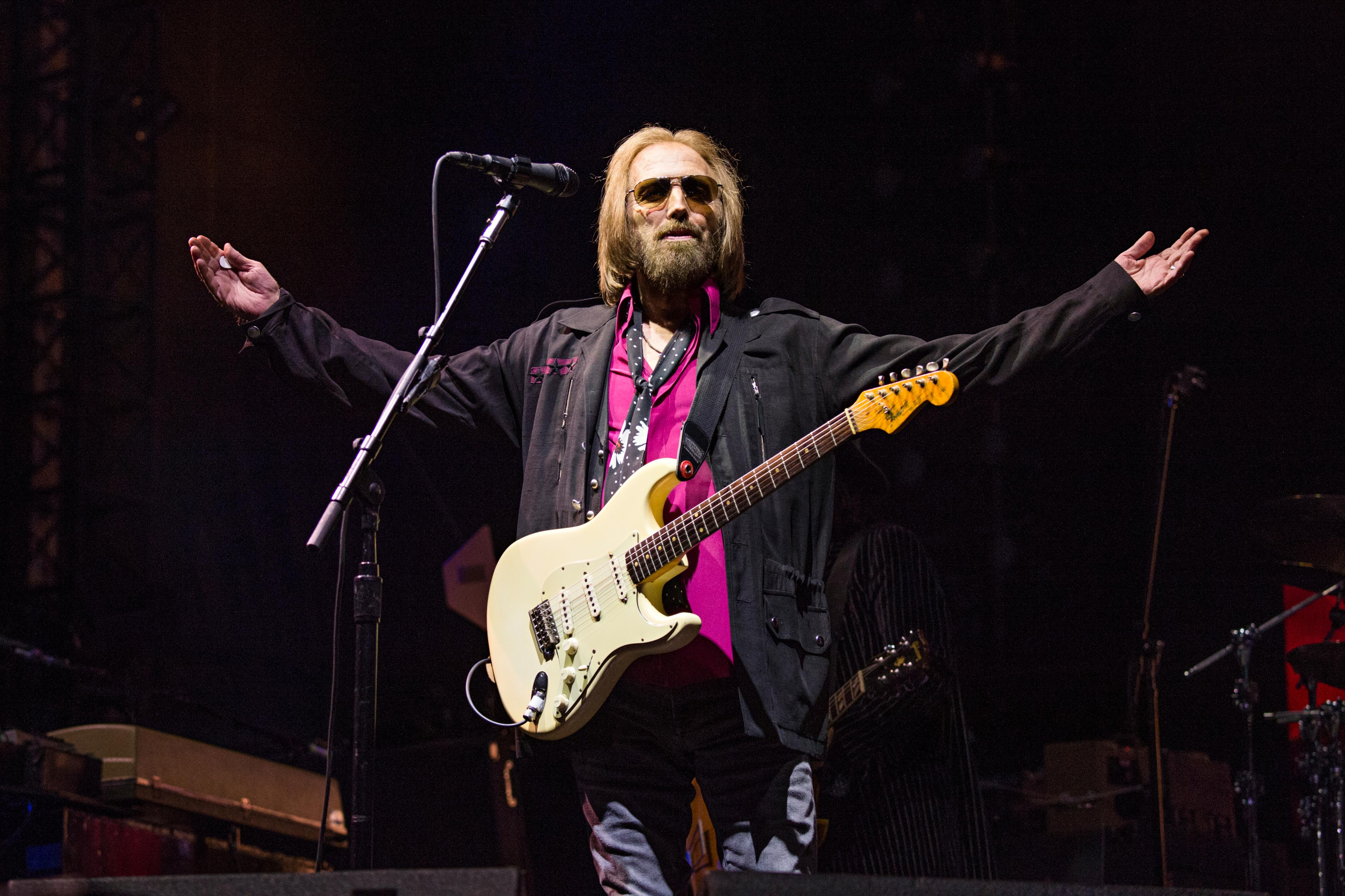 "FILE - In this Sept. 17, 2017 file photo, Tom Petty of Tom Petty and the Heartbreakers appears at KAABOO 2017 in San Diego, Calif. A spokesman for the Los Angeles Police Department says it has no information on the well-being of Tom Petty and its spokespeople did not provide info CBS News used to report the rocker had died. News outlets reported Monday, Oct. 2, that Petty was dead at age 66. CBS did not cite a source in its story, but tweeted that LAPD confirmed Petty's death. CBS now says he is ""clinging to life."" (Photo by Amy Harris/Invision/AP, File)"